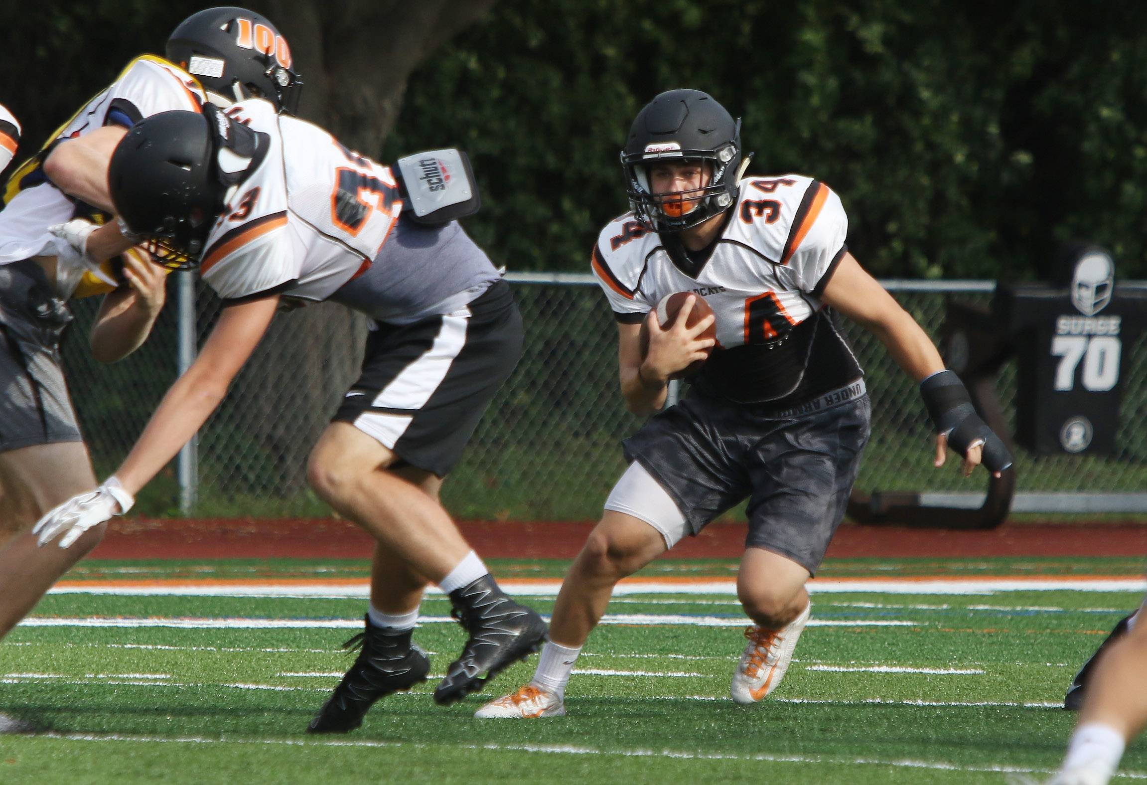 Running back Brendan Bazar runs with the ball during football practice at Libertyville High School.