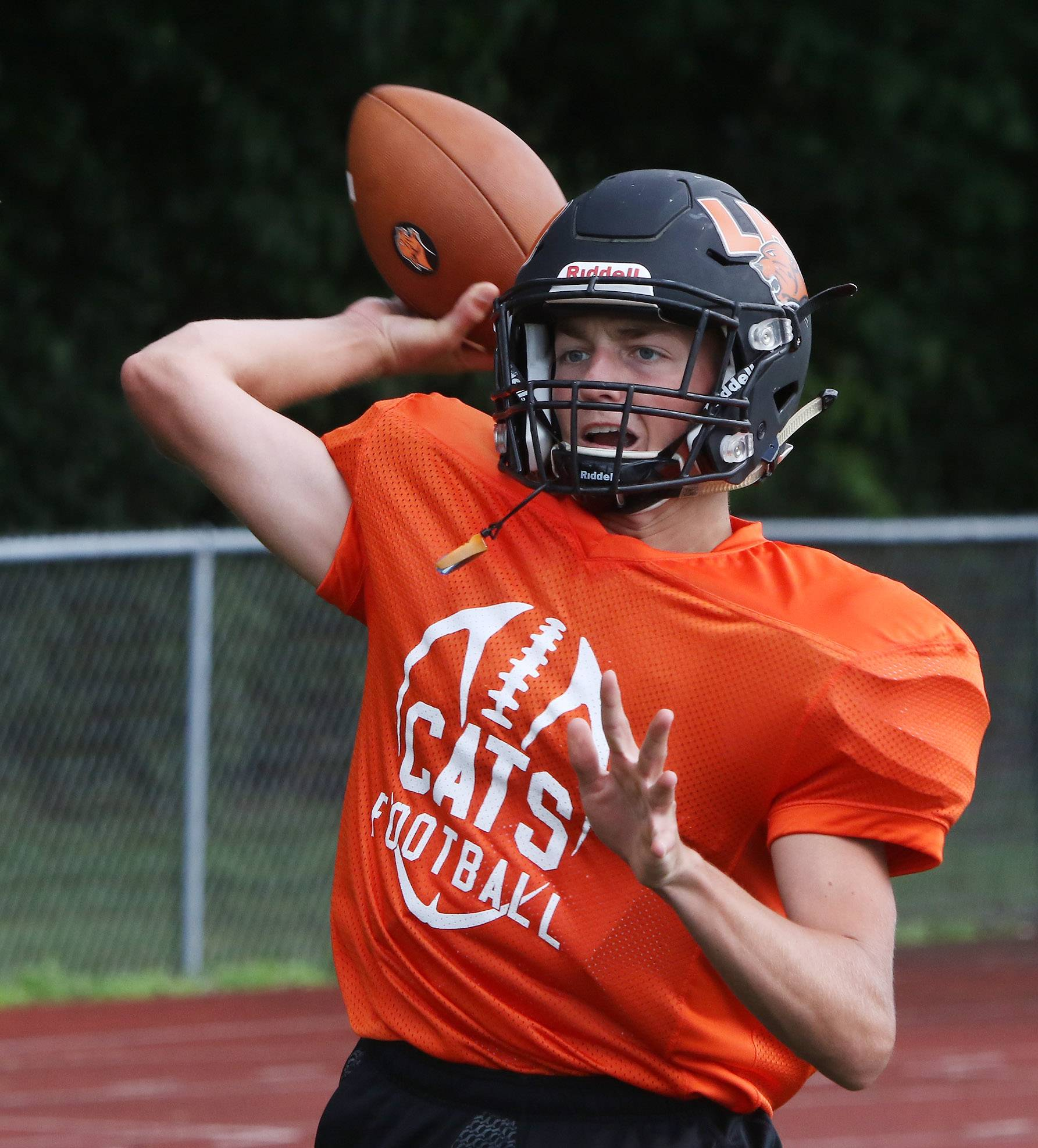 Quarterback Alex Stanulis throws the ball during football practice at Libertyville.