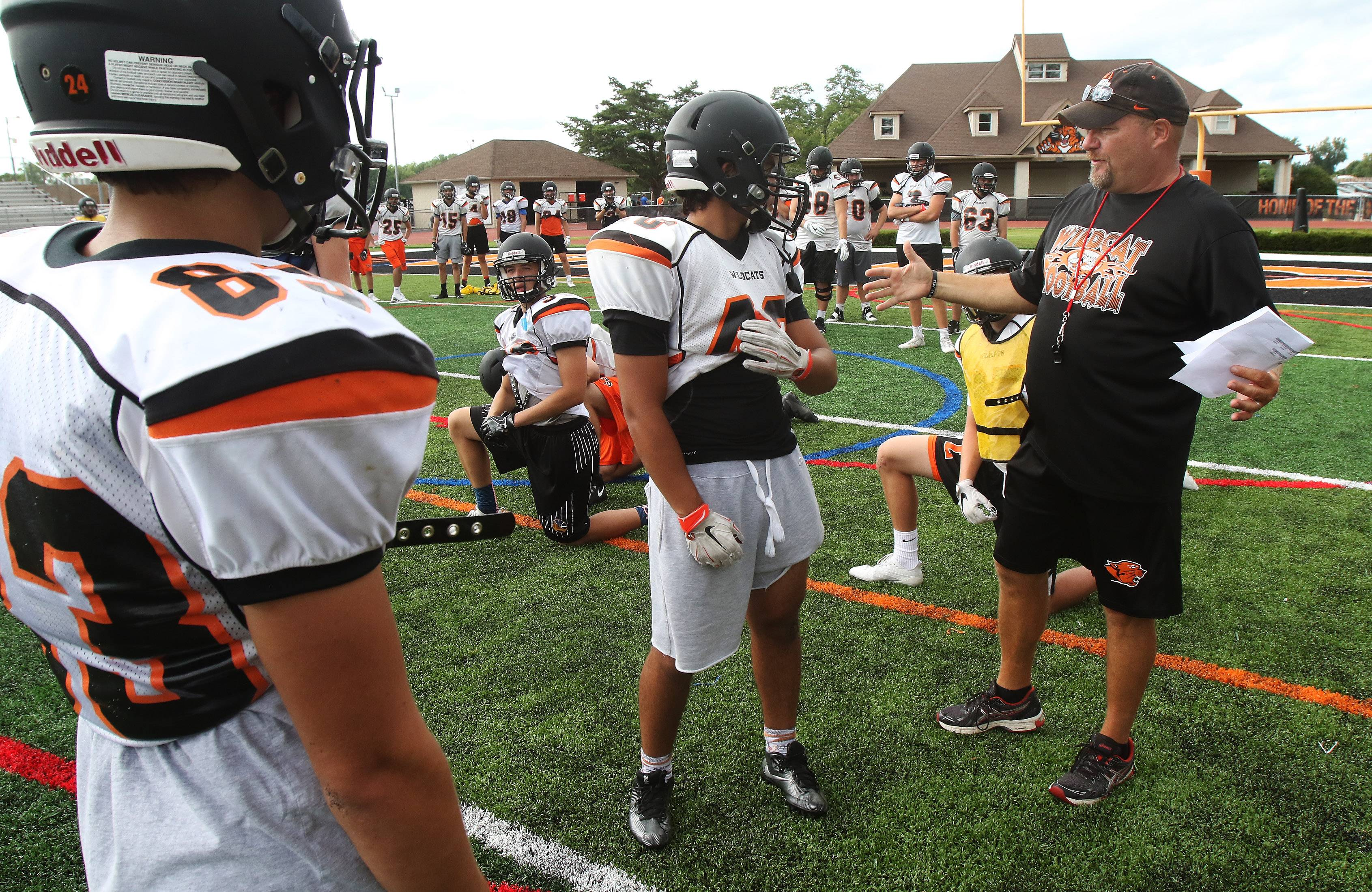 Coach Mike Jones discusses an offensive formation during football practice at Libertyville.
