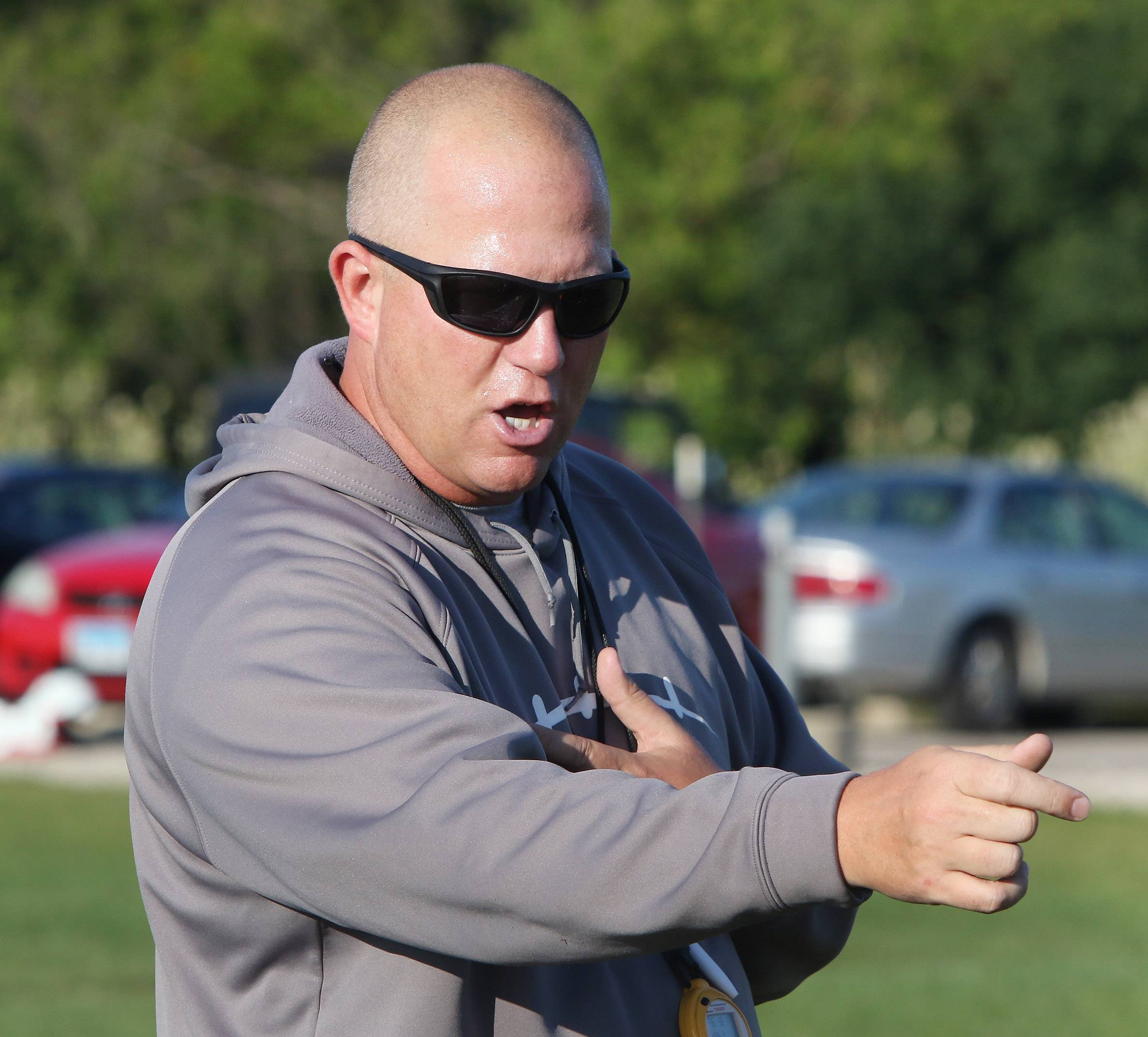 Coach Brian Glashagel directs his players during football practice at Antioch High School on Wednesday.