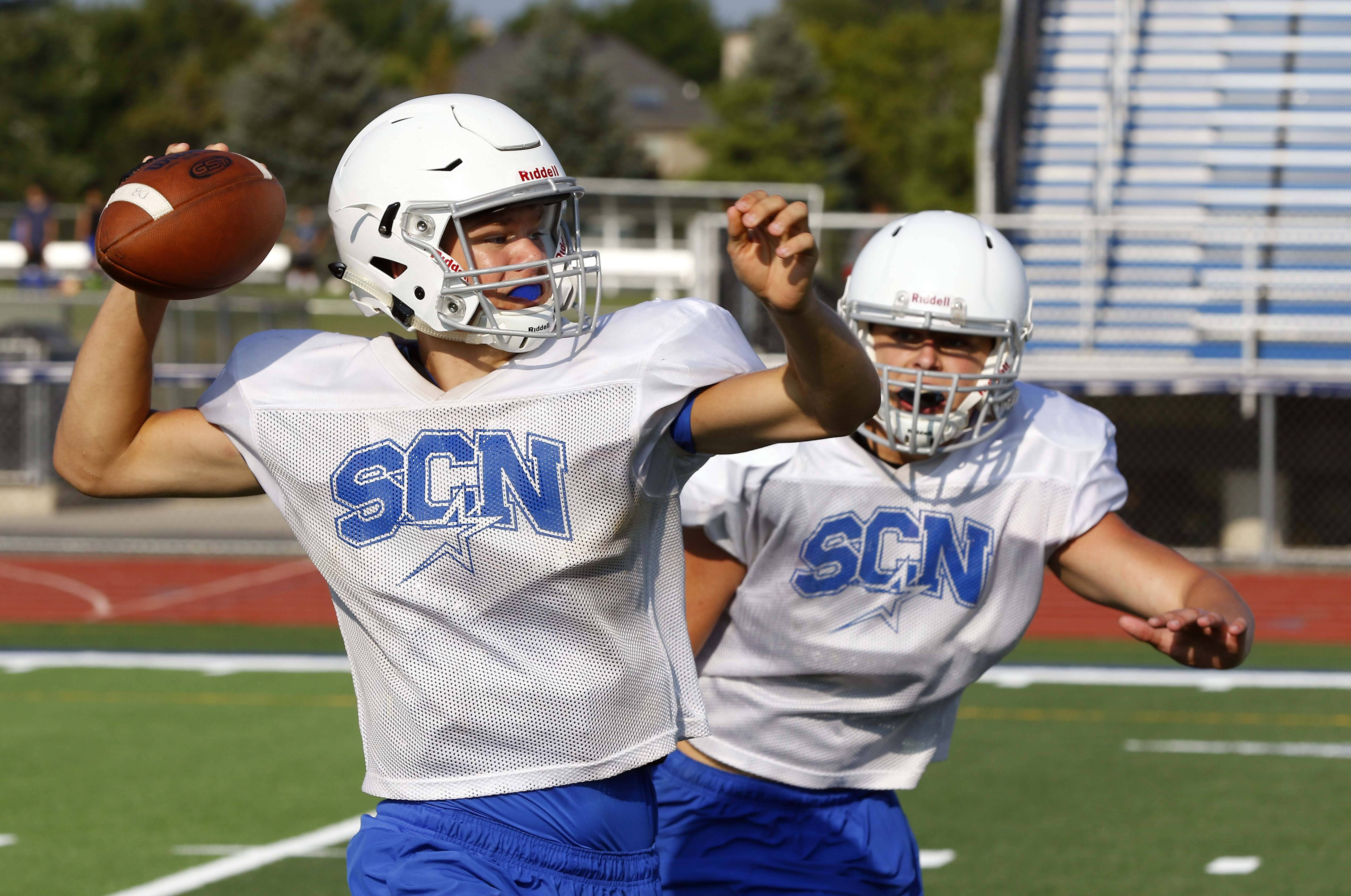 David Beech looks for an open teammate during St. Charles North football practice.