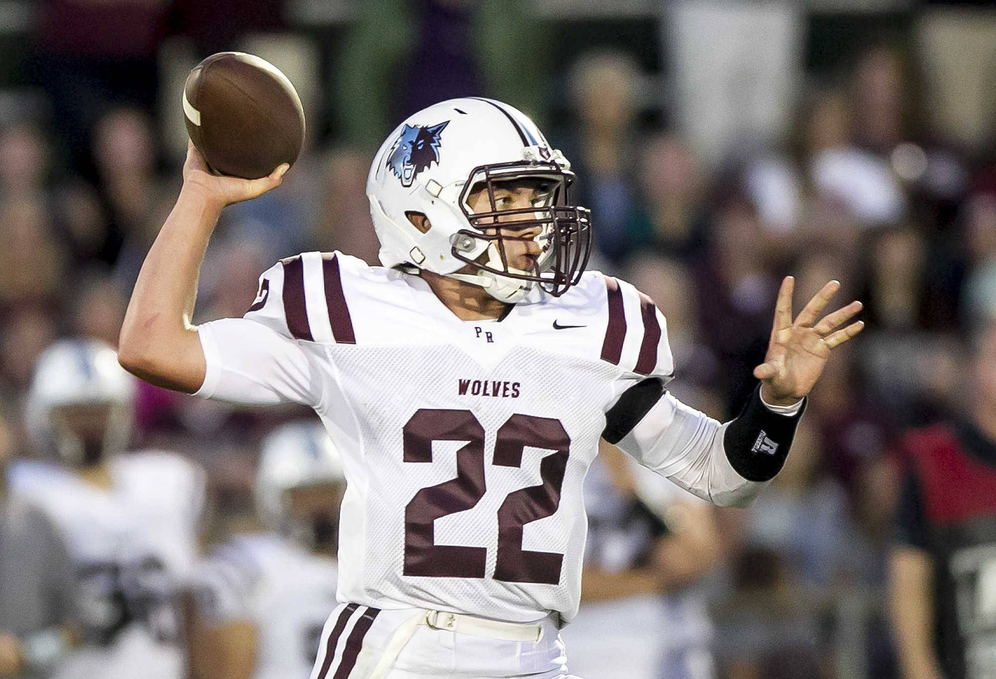Prairie Ridge's Samson Evans throws a pass against Cary-Grove last season. Evans, an Iowa recruit who led the Wolves to the Class 6A state title last season returns to quarterback PR in 2017.
