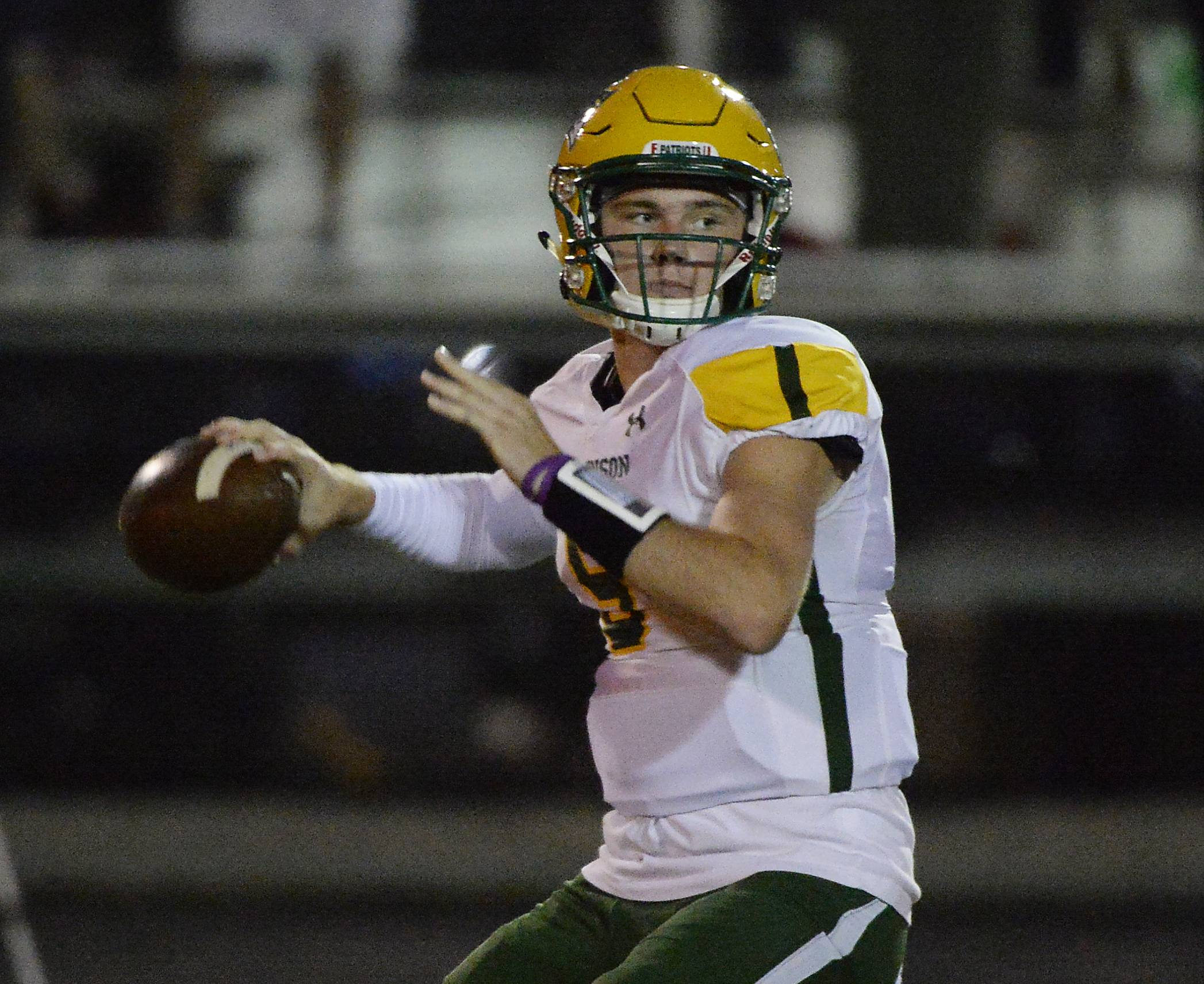 Stevenson quarterback Grayson Kubow looks downfield for a receiver against Palatine on Friday.