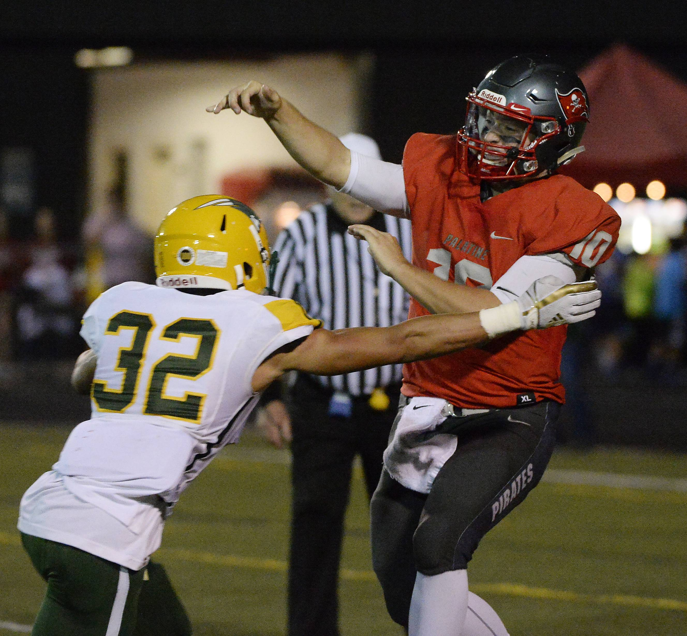 Stevenson's Jordan Vincent applies pressure to Palatine quarterback DJ Angelaccio as he releases the ball on Friday at Palatine.