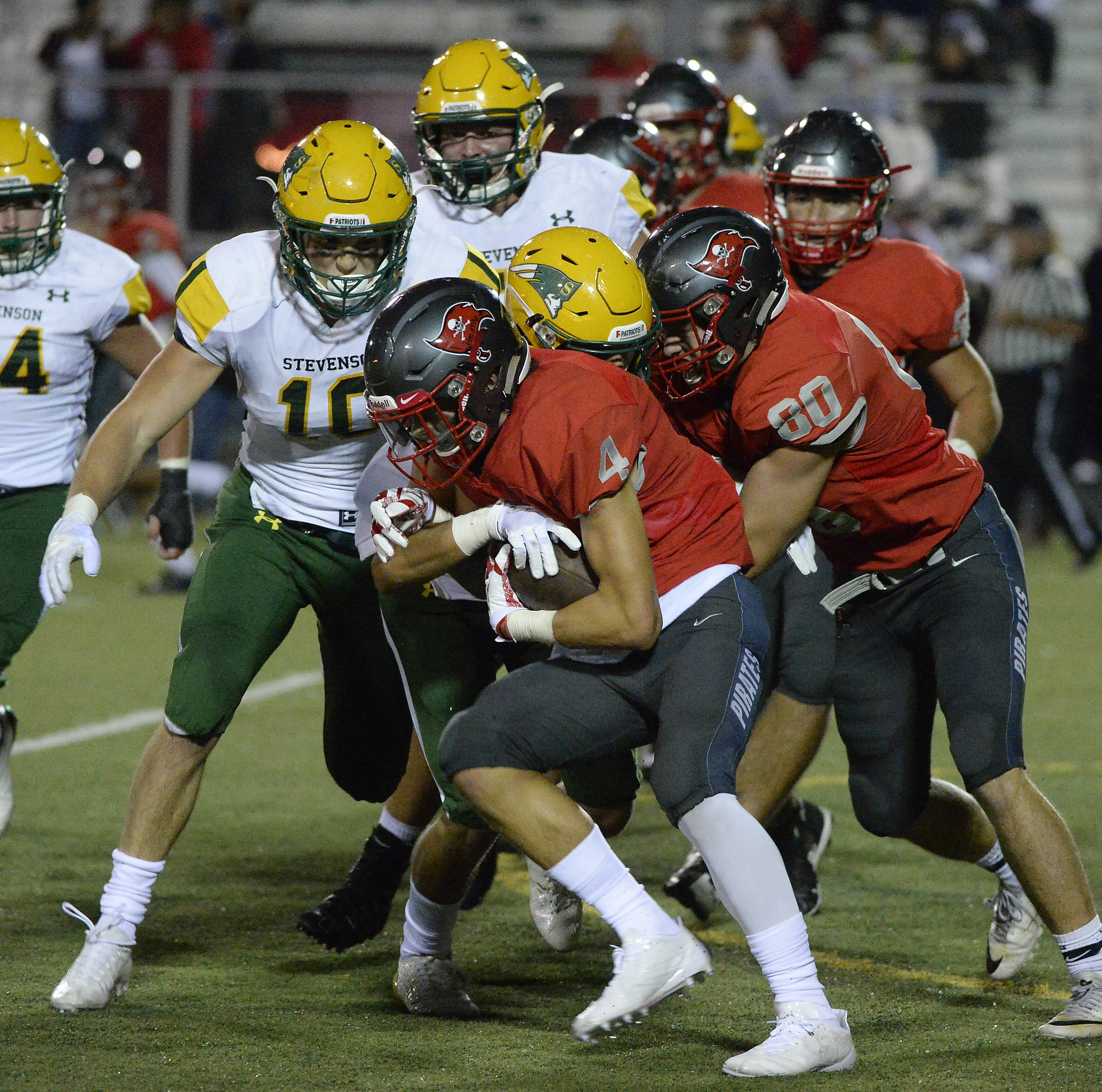Palatine's Jake Orlando is stopped by Stevenson's defense on Friday.