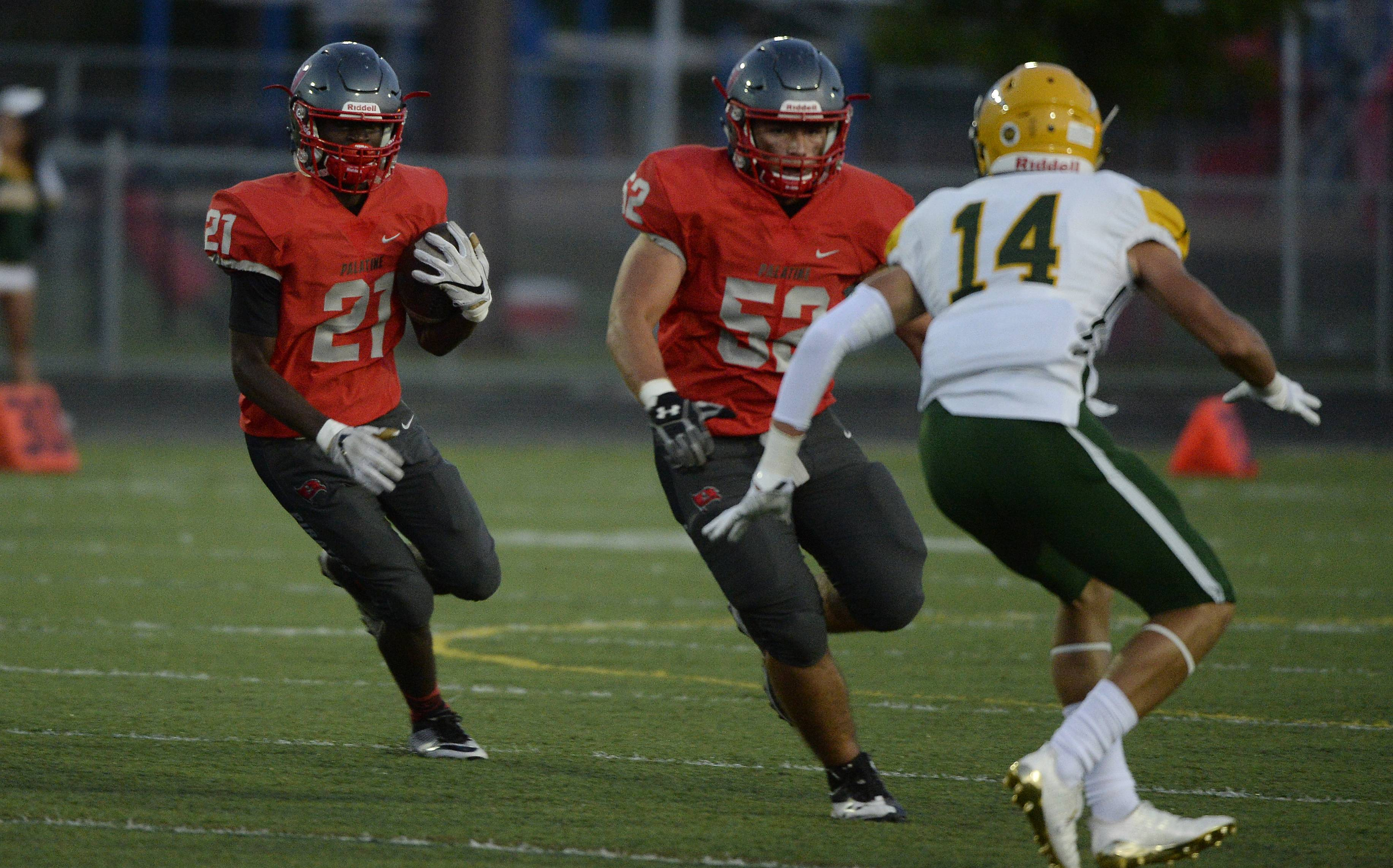 Palatine running back Marshawn Rayford looks for a crease in the first quarter against visiting Stevenson on Friday.
