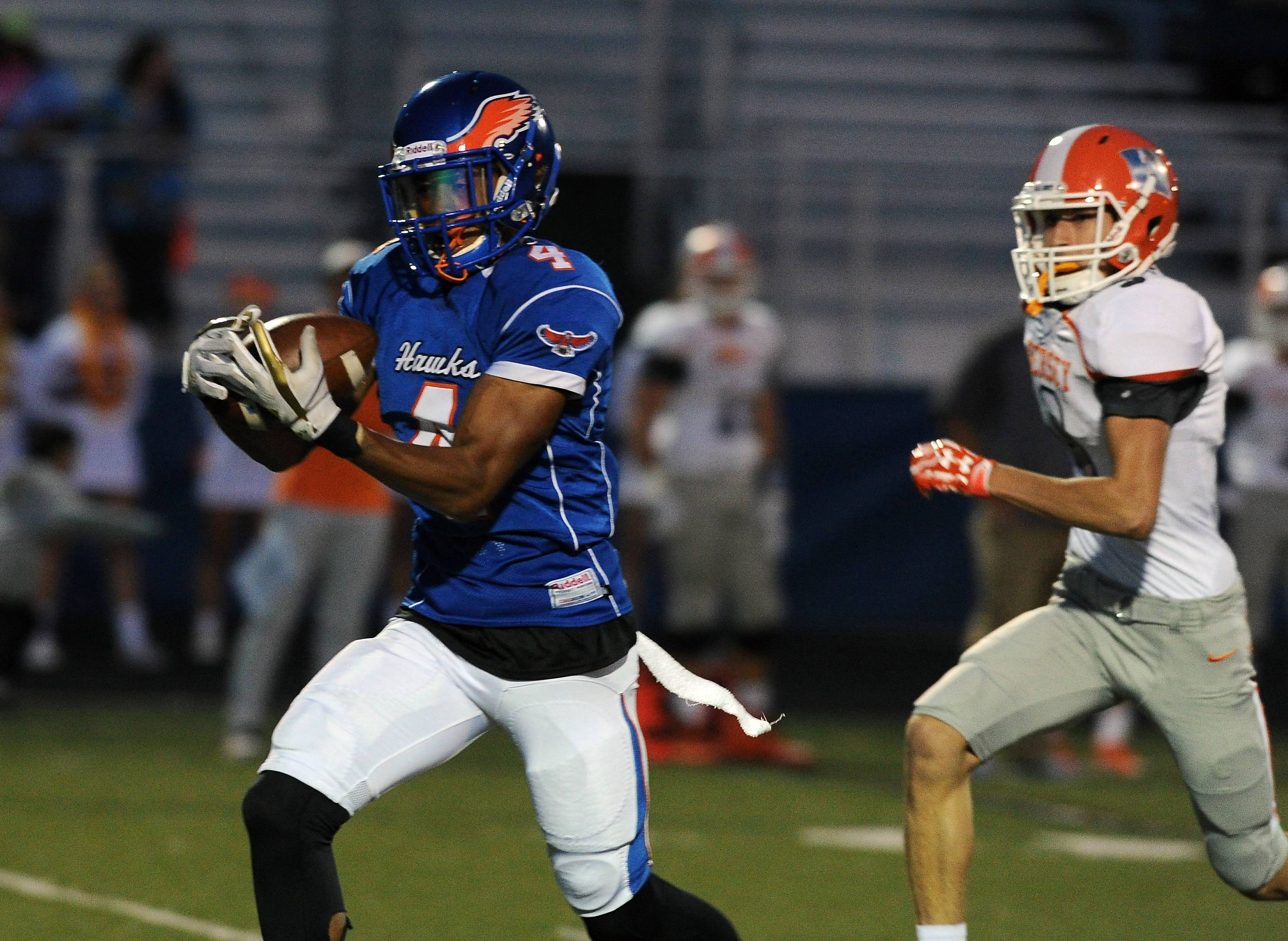 Hoffman Estates' Jayvon Blissett hauls in a touchdown pass in the first quarter against Hersey at Hoffman Estates.
