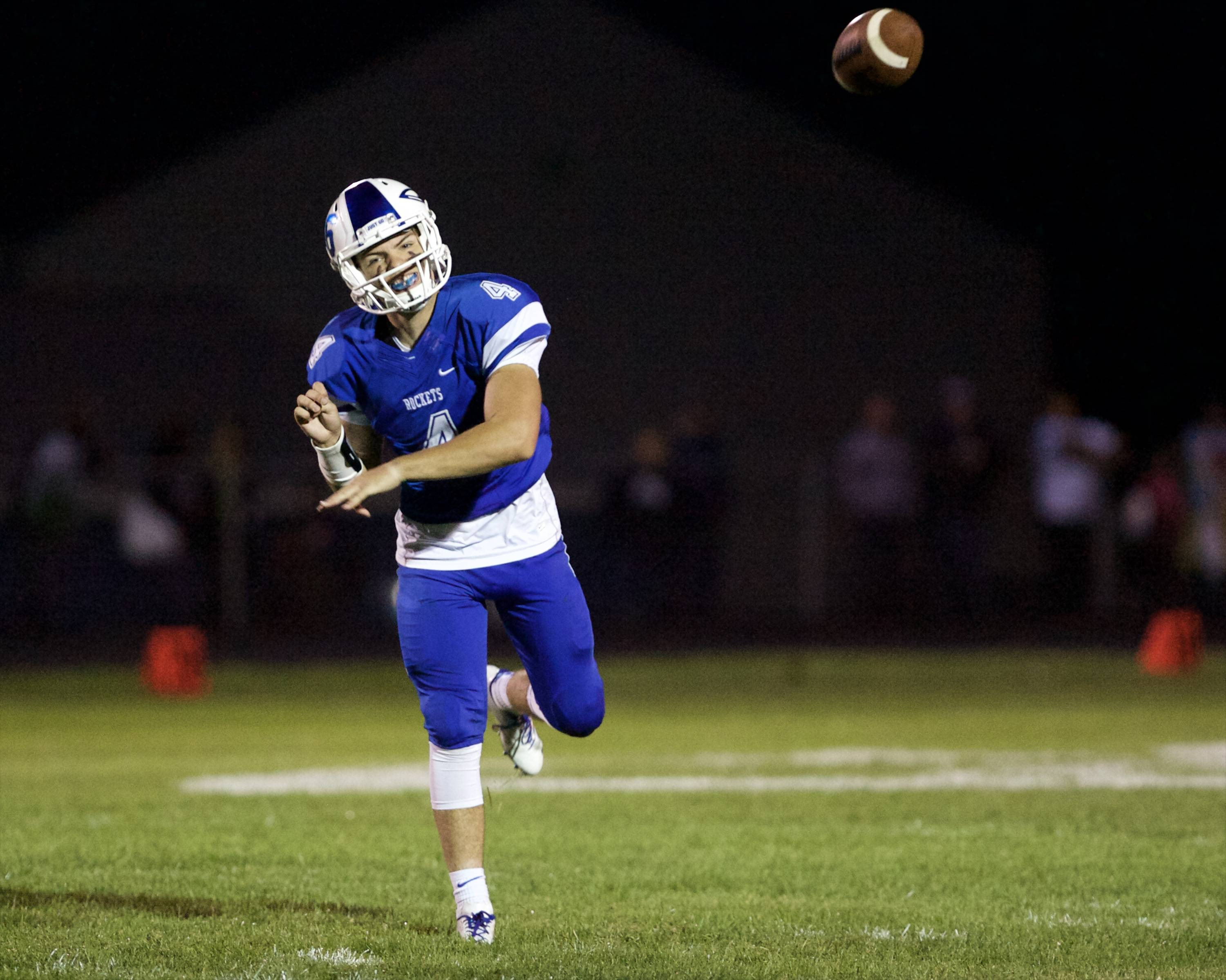 Burlington Central's Johnny DiCostanzo throws for yardage against Hampshire on Friday in Burlington.
