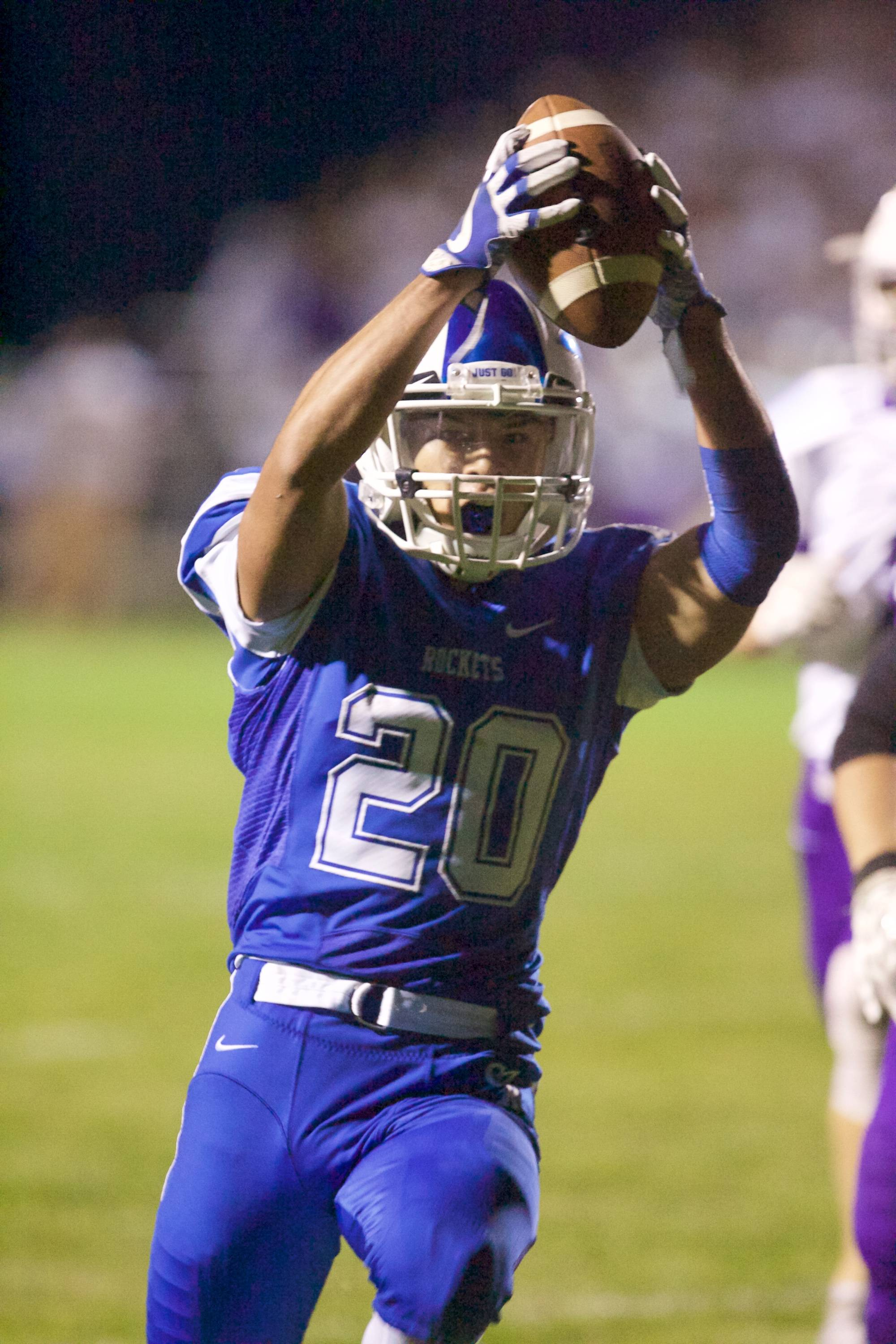 Burlington Central's Nicholas Termini carries the ball for a touchdown against Hampshire on Sept 1 in Burlington.