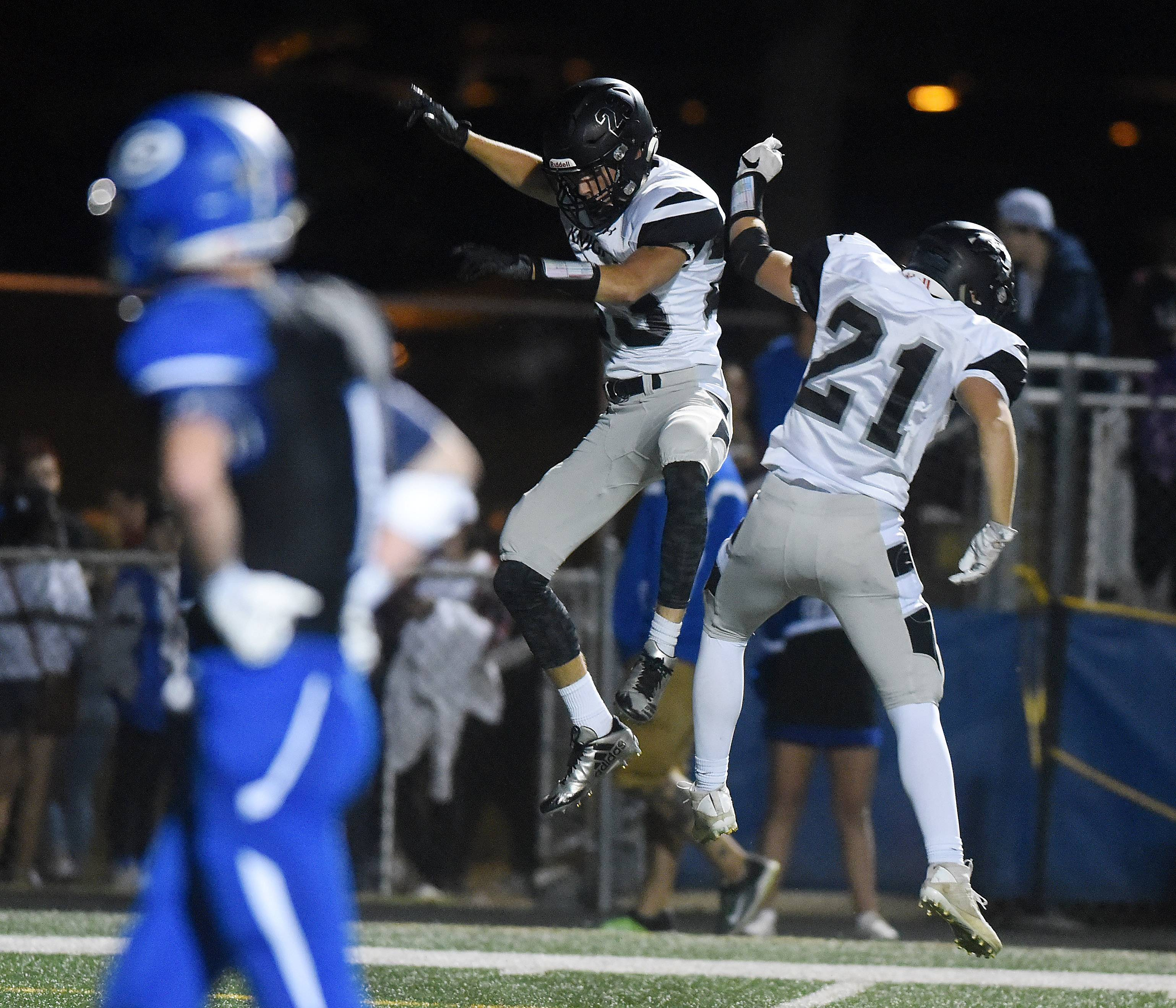 Kaneland's Josh Marczuk (23) celebrates with teammate Alex Moses (21) after a touchdown during Friday's game in Geneva.