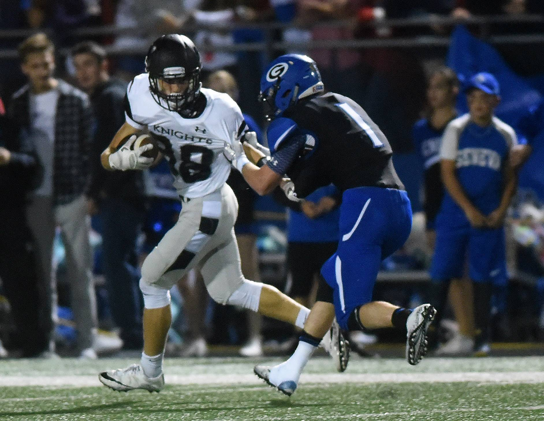 Kaneland's Max Gagne (88) is brought down by Geneva's Ian Hanson (1) after a 48-yard reception during Friday's game in Geneva.