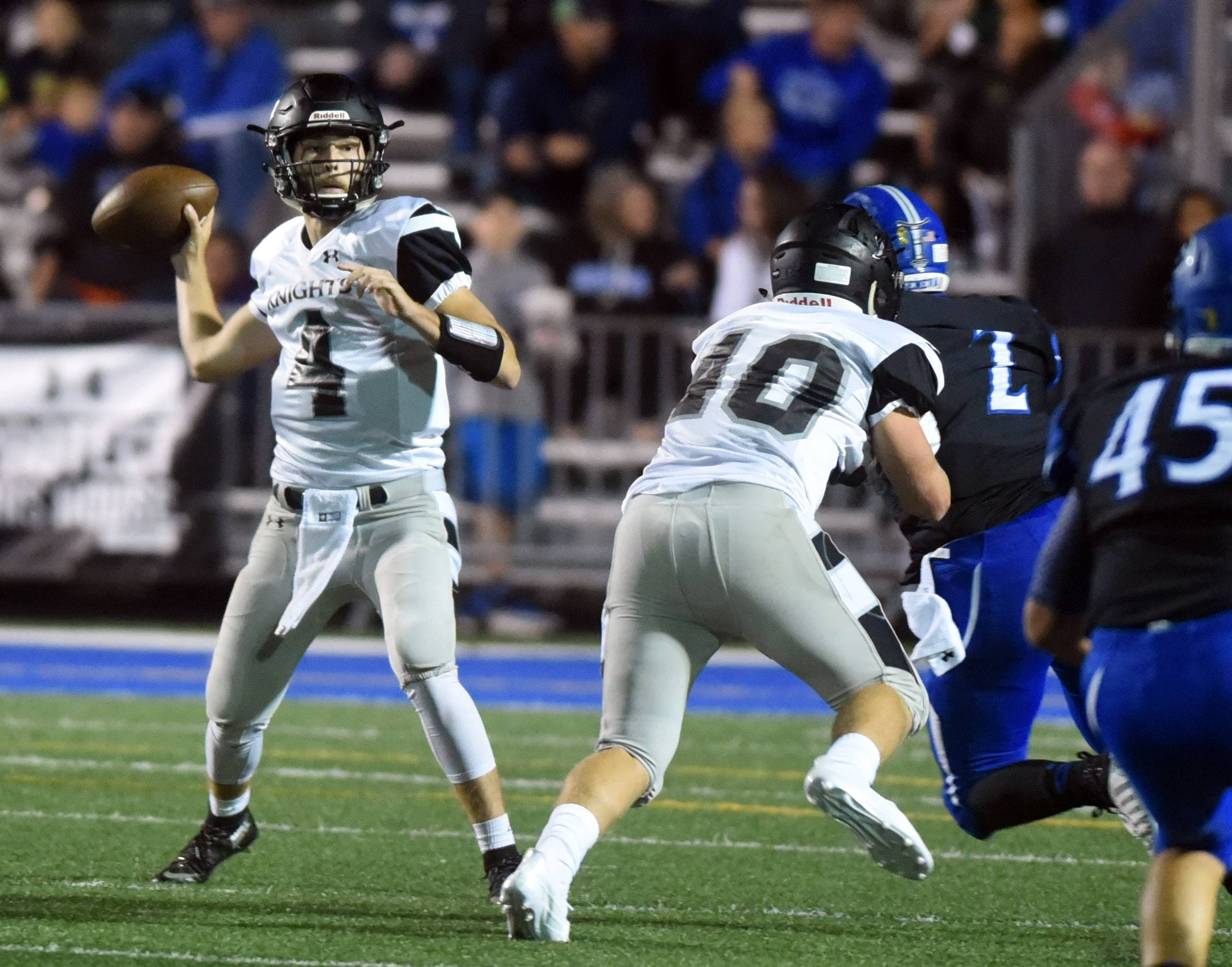 Kaneland quarterback Jack Douglas (4) rears back to pass against Geneva during Friday's game in Geneva.