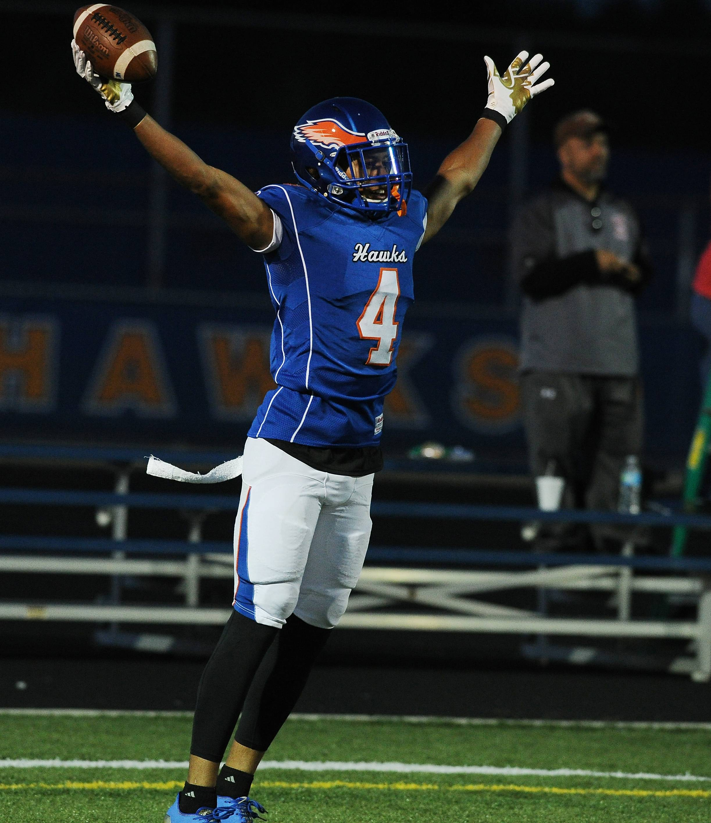 Hoffman Estates' Jayvon Blissett celebrates after hauling in a touchdown pass in the first quarter against visiting Hersey on Friday.