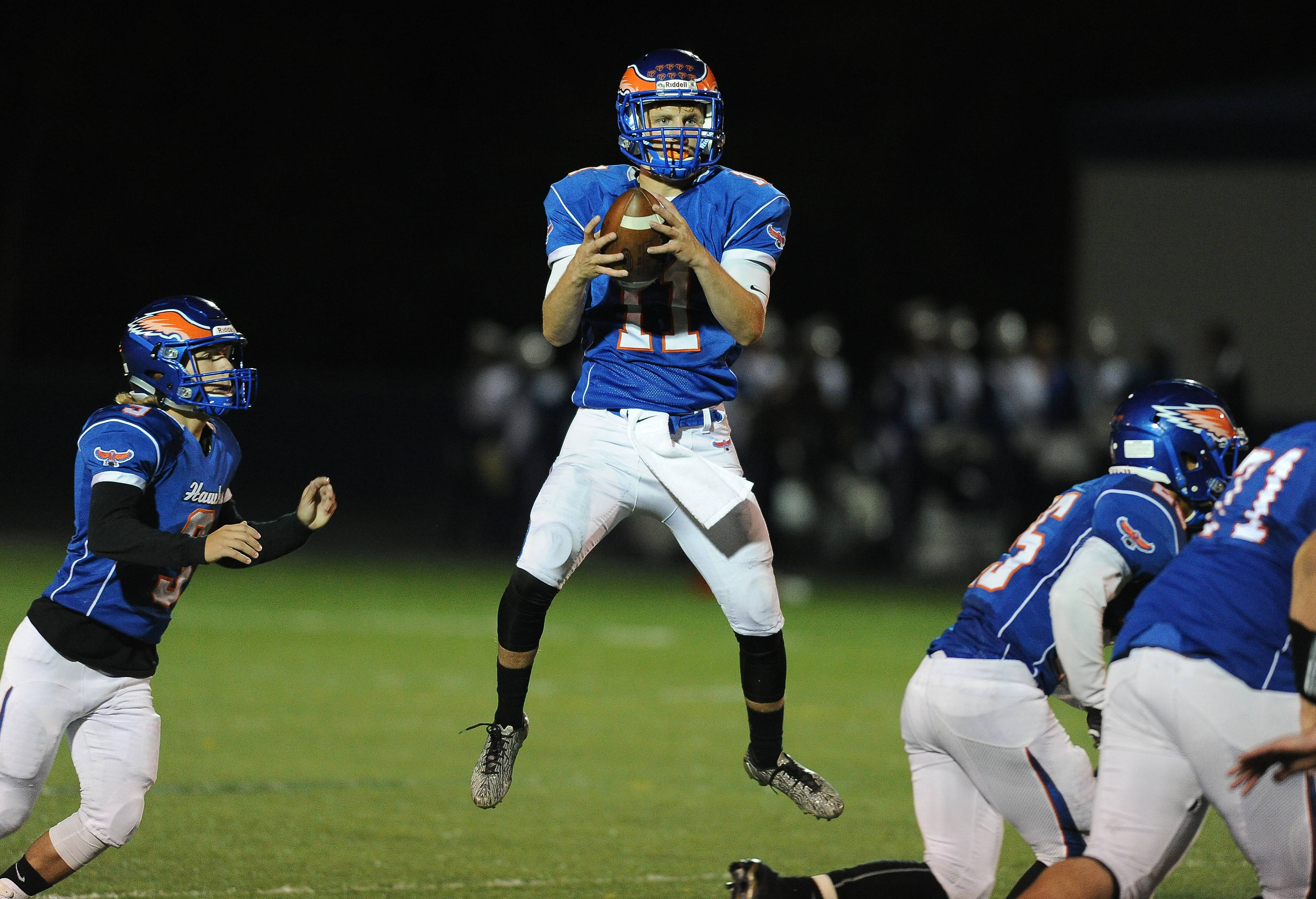 Hoffman Estates quarterback Austin Coalson delivers to a receiver in the first half against visiting Hersey on Friday.