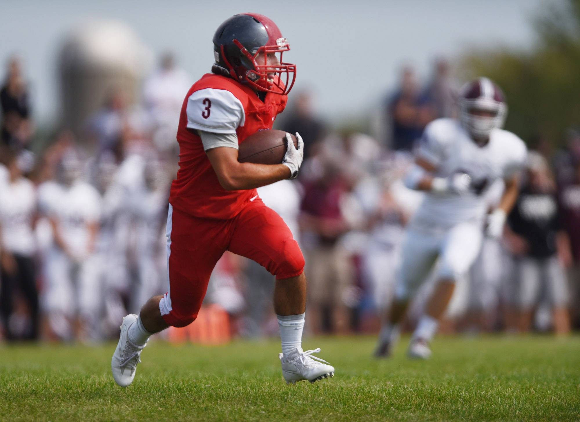 South Elgin's Joey Cipriani makes a large gain against Lockport Saturday in South Elgin.