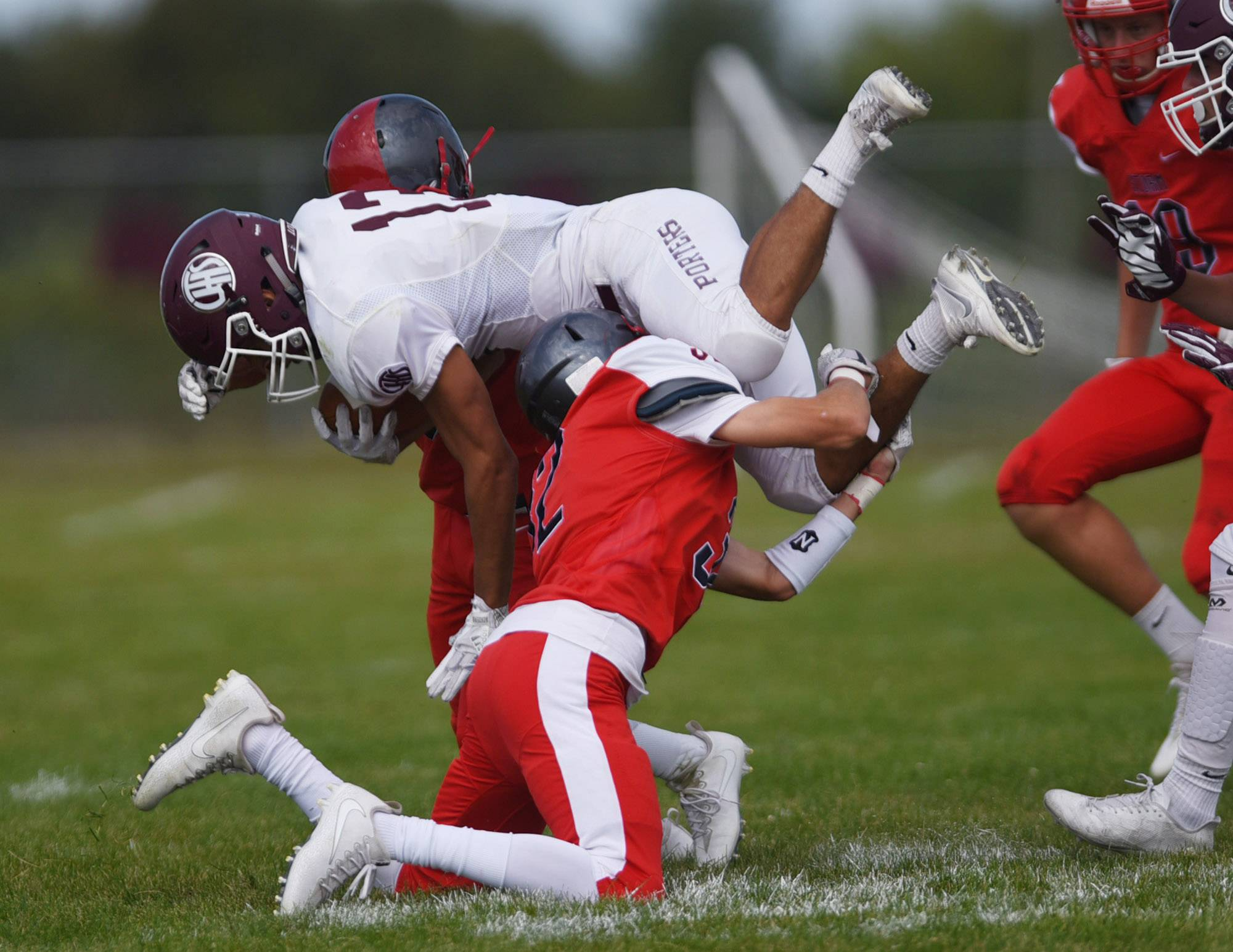 South Elgin's Anthony Zabran makes an open-field tackle against Lockport's Nicholas Ward Saturday in South Elgin.