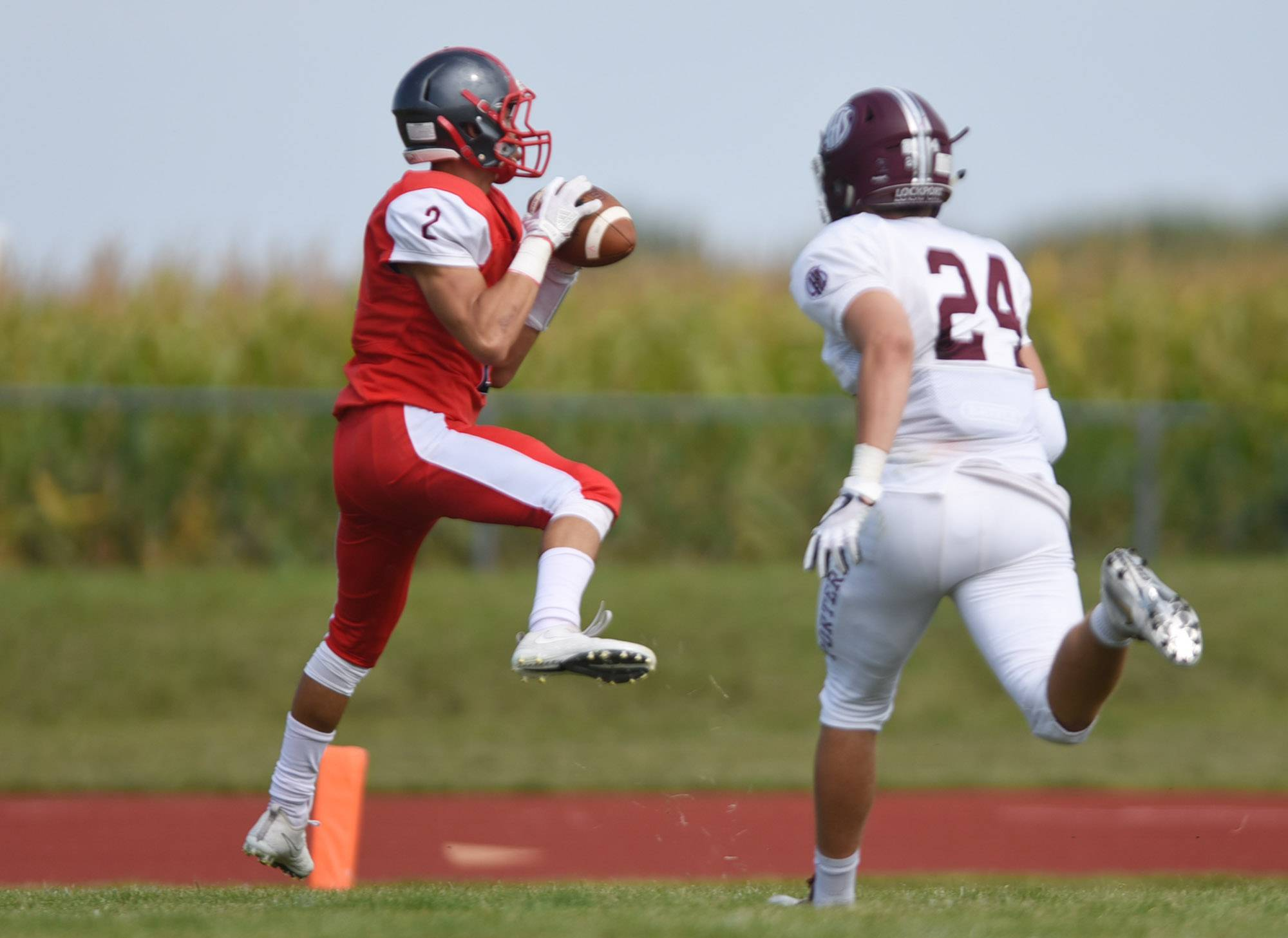South Elgin's Azxavier Salinas catches a touchdown pass in the first half against Lockport Saturday in South Elgin.