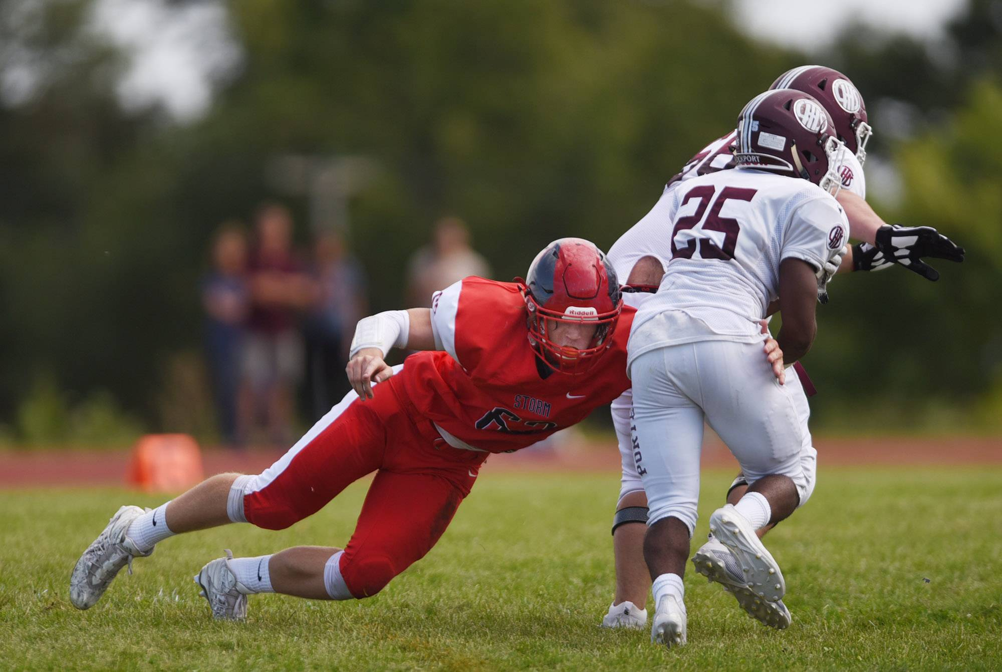 South Elgin's Kyle Viverito wraps up Lockport's Tavares Moore Saturday in South Elgin.