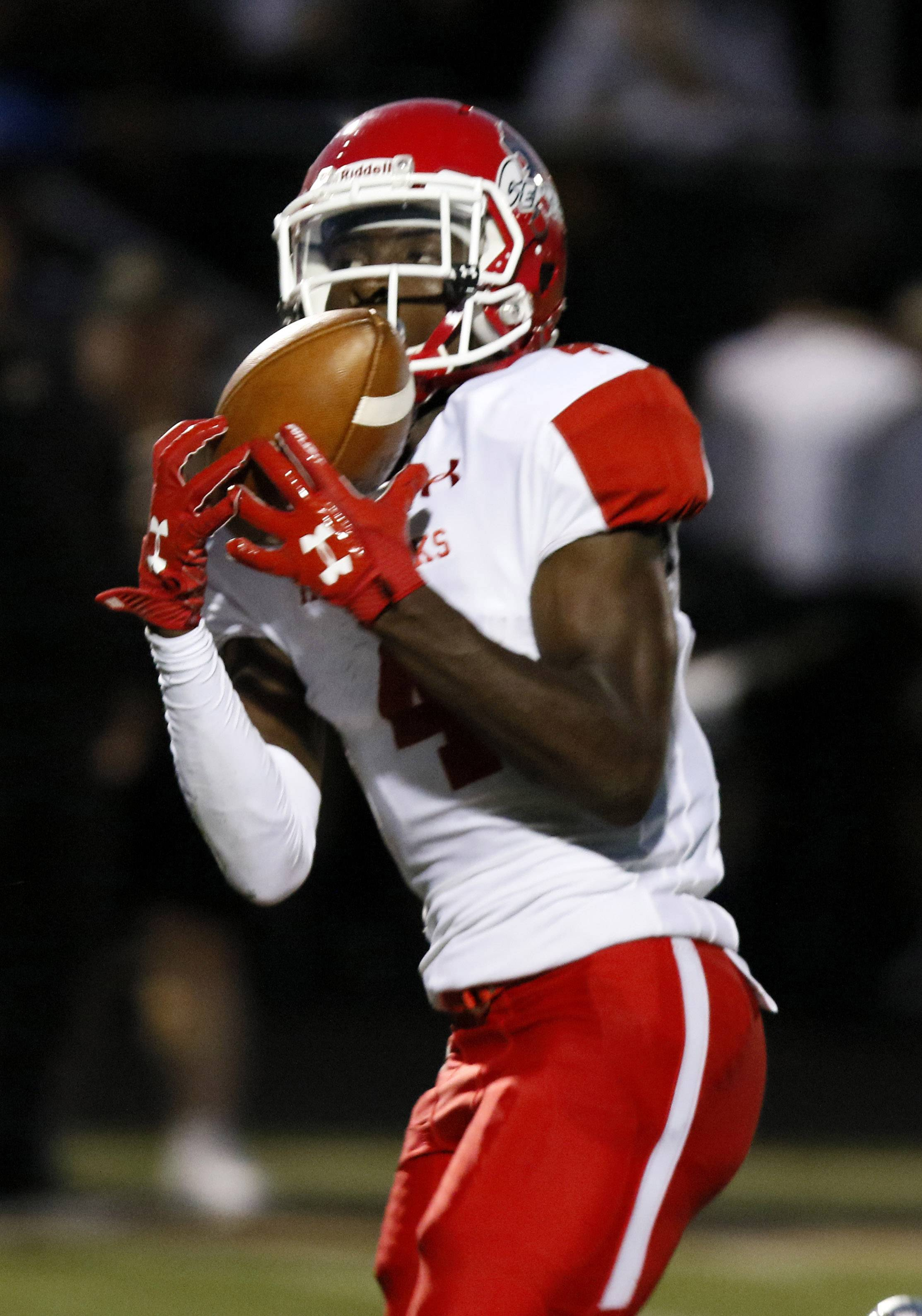 Naperville Central's Jayden Reed hauls in a first quarter touchdown catch against Glenbard North, during opening night football action in Carol Stream.