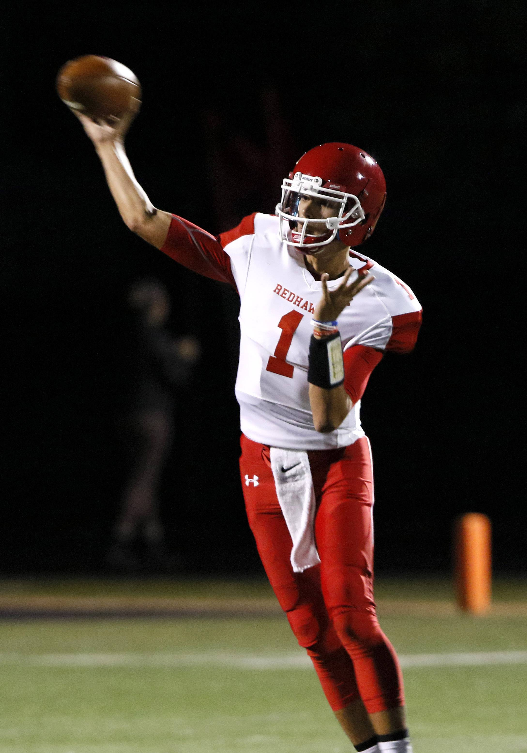 Naperville Central quarterback Payton Thorne fires a pass against Glenbard North.