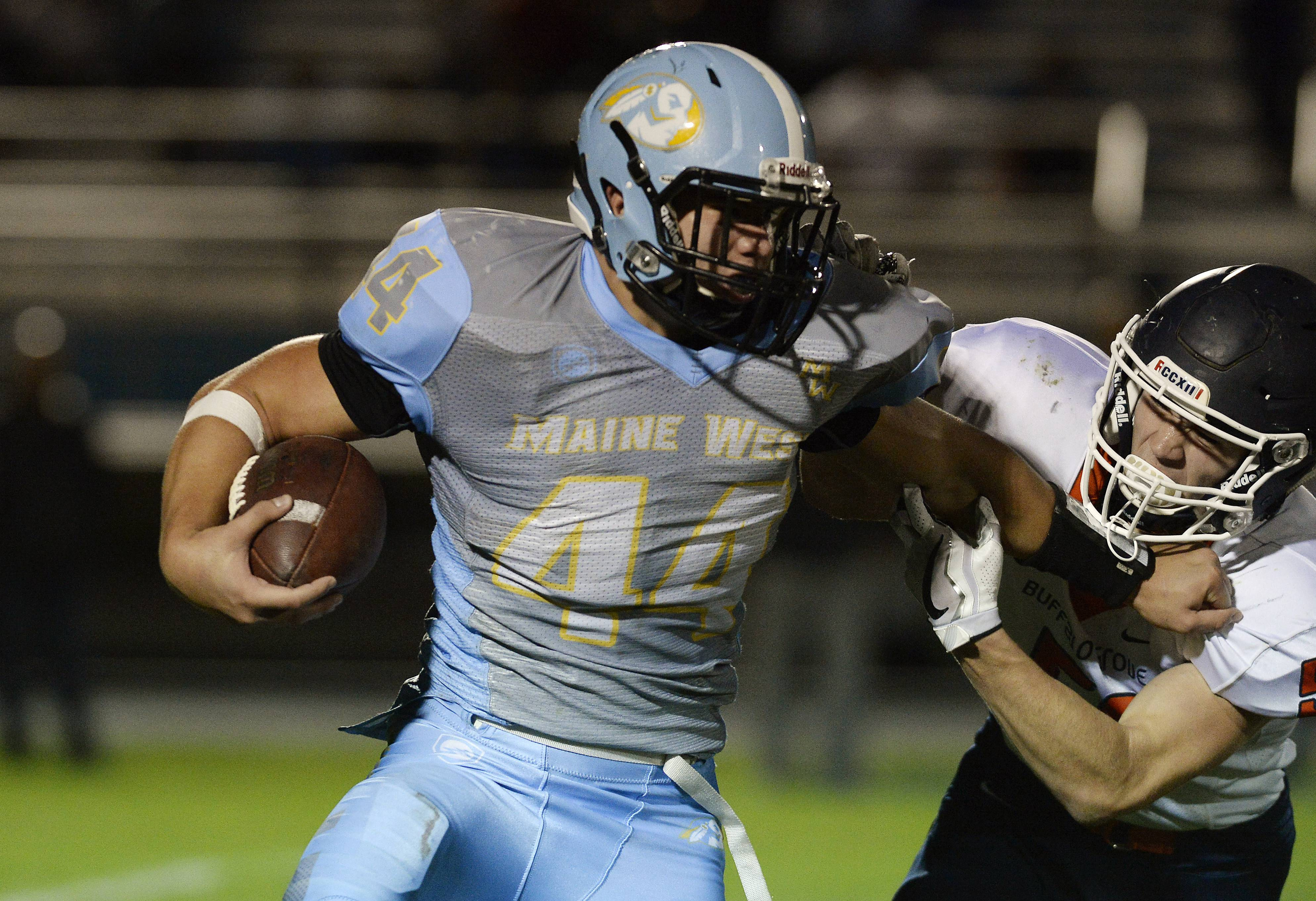 Buffalo Grove's Andrew Polk brings down Maine West's Jake Bellizzi on Friday in Des Plaines.