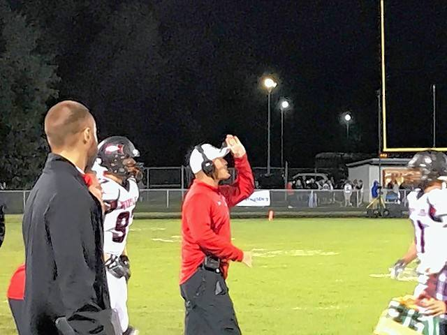 Huntley assistant coach Paul Reinke directs the Red Raiders as their interim head coach Friday night against Dundee-Crown. Reinke took over for head coach Matt Zimozlak, who was serving a one-game suspension after being ejected from last week's game against Prairie Ridge.