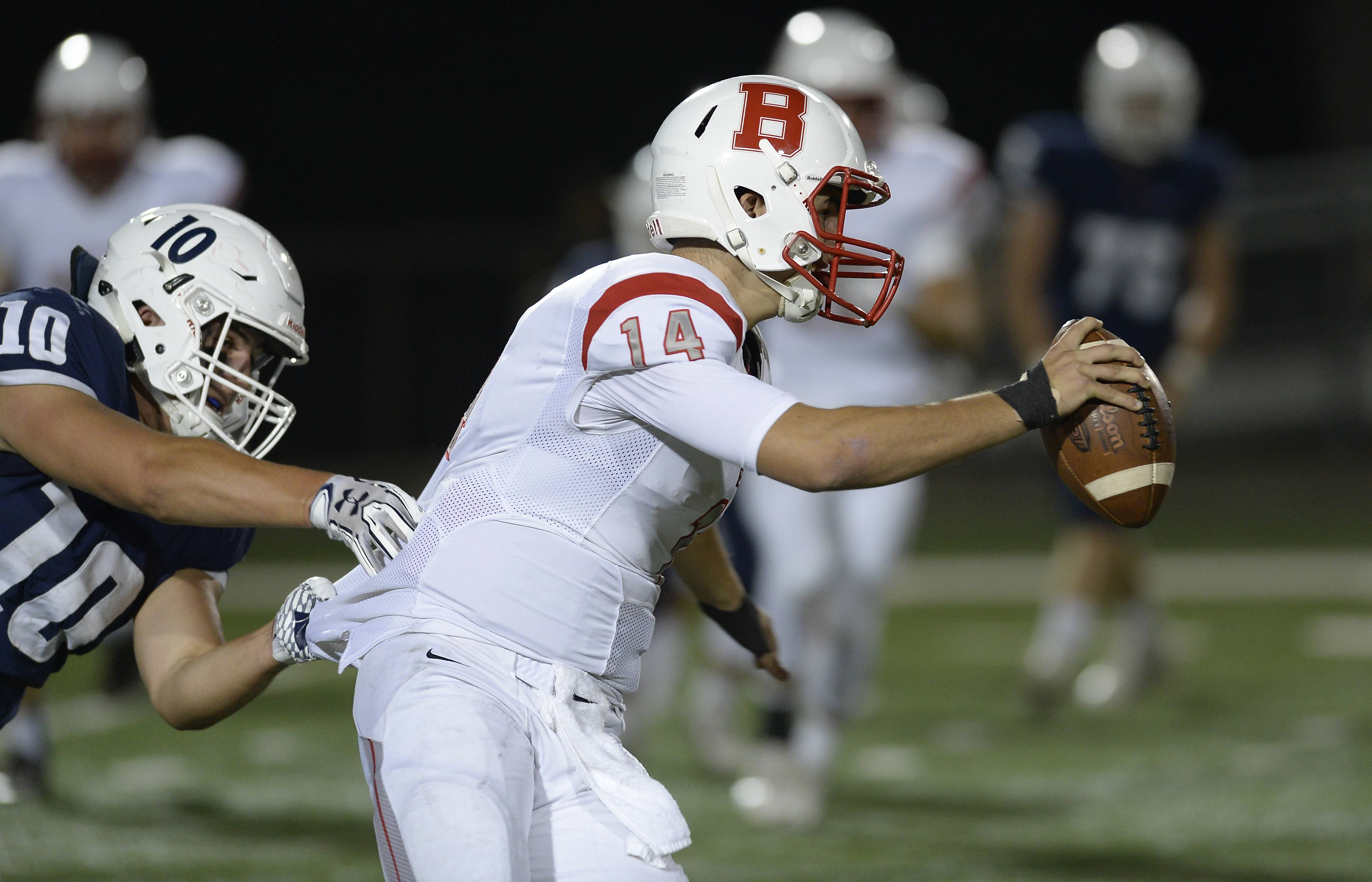 St. Viator's Niko Weder drags down Benet Academy's quarterback Matthew Boyle for a first-half sack Friday in Arlington Heights.