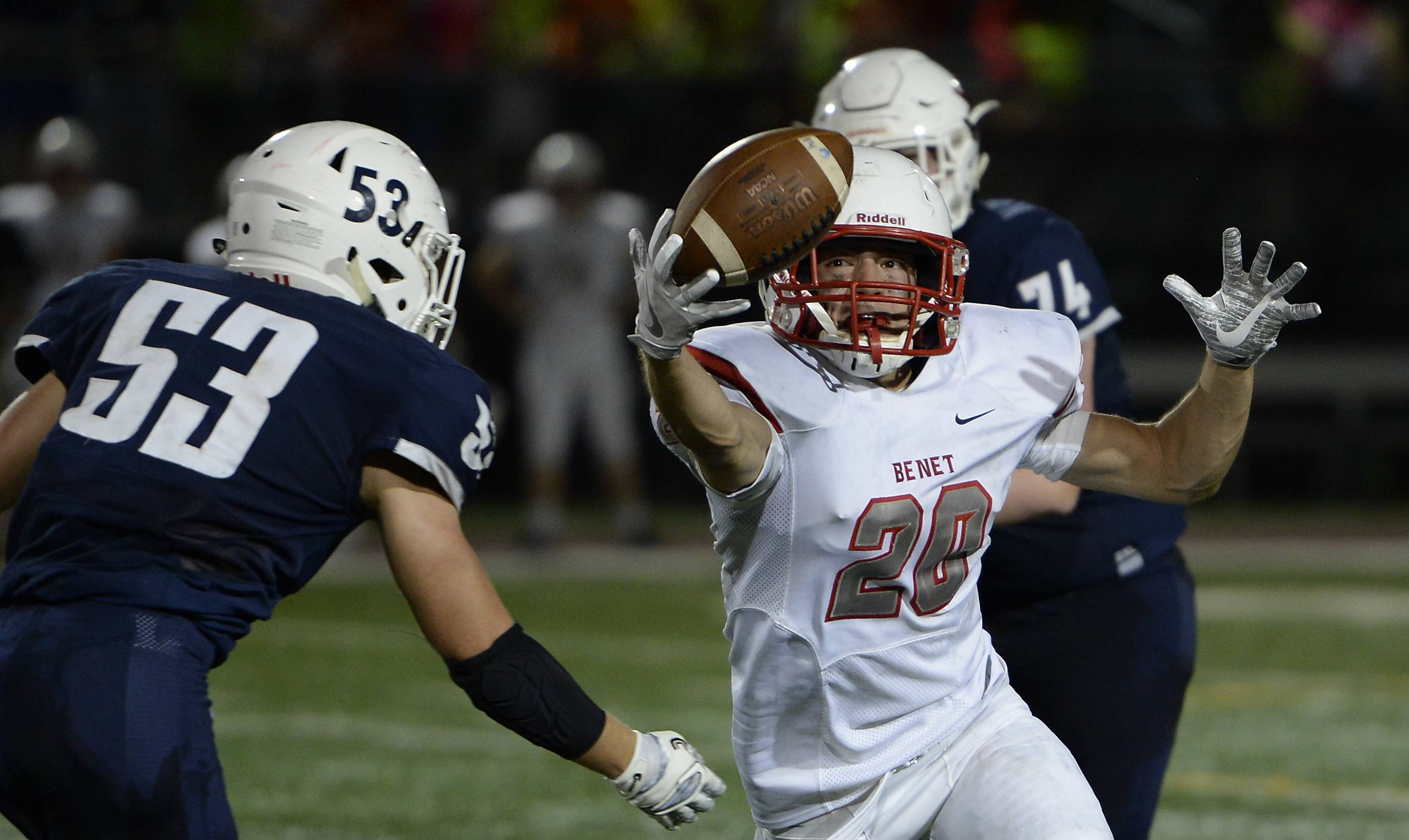 St. Viator's Jake Wolf breaks up a pass play as Benet Academy's Bennett Hickey fails to haul it in during the first half Friday in Arlington Heights.