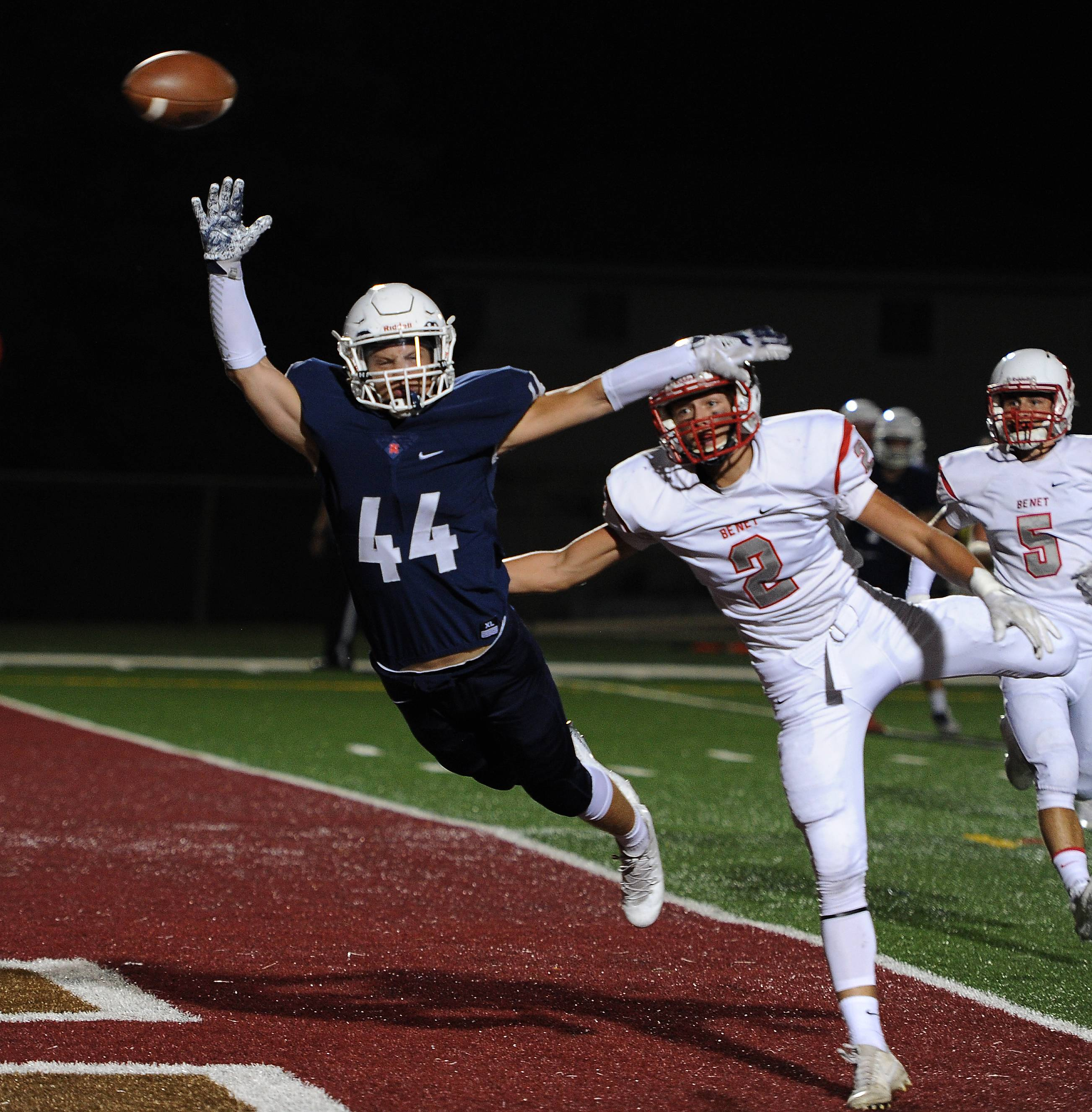 St. Viator's Michael Wittich tries to haul in a first-quarter pass play in the end zone but falls short as Benet Academy's Jack Cooney defends during the first half Friday in Arlington Heights.