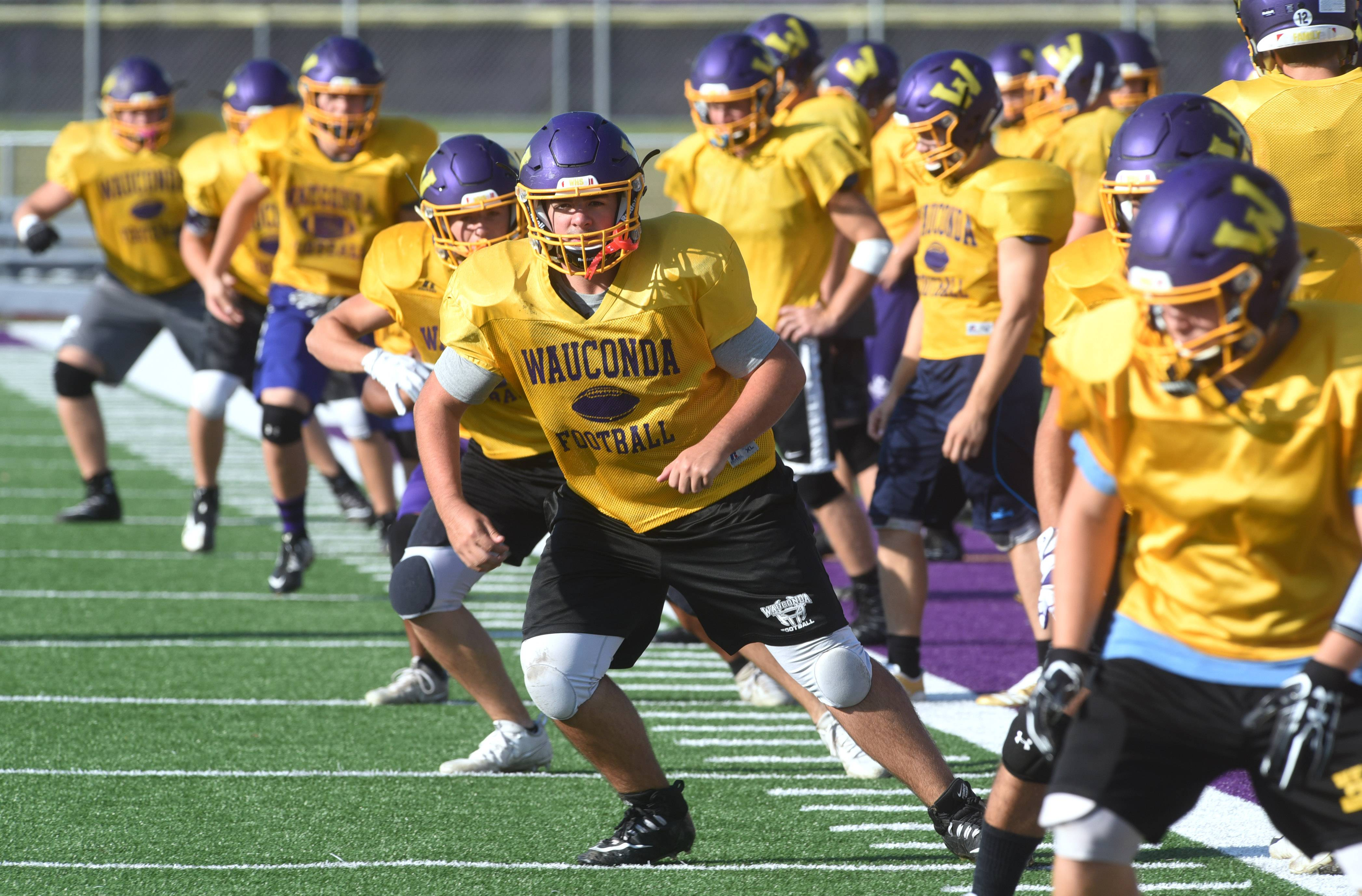 Wauconda football players practice Wednesday on the turf.