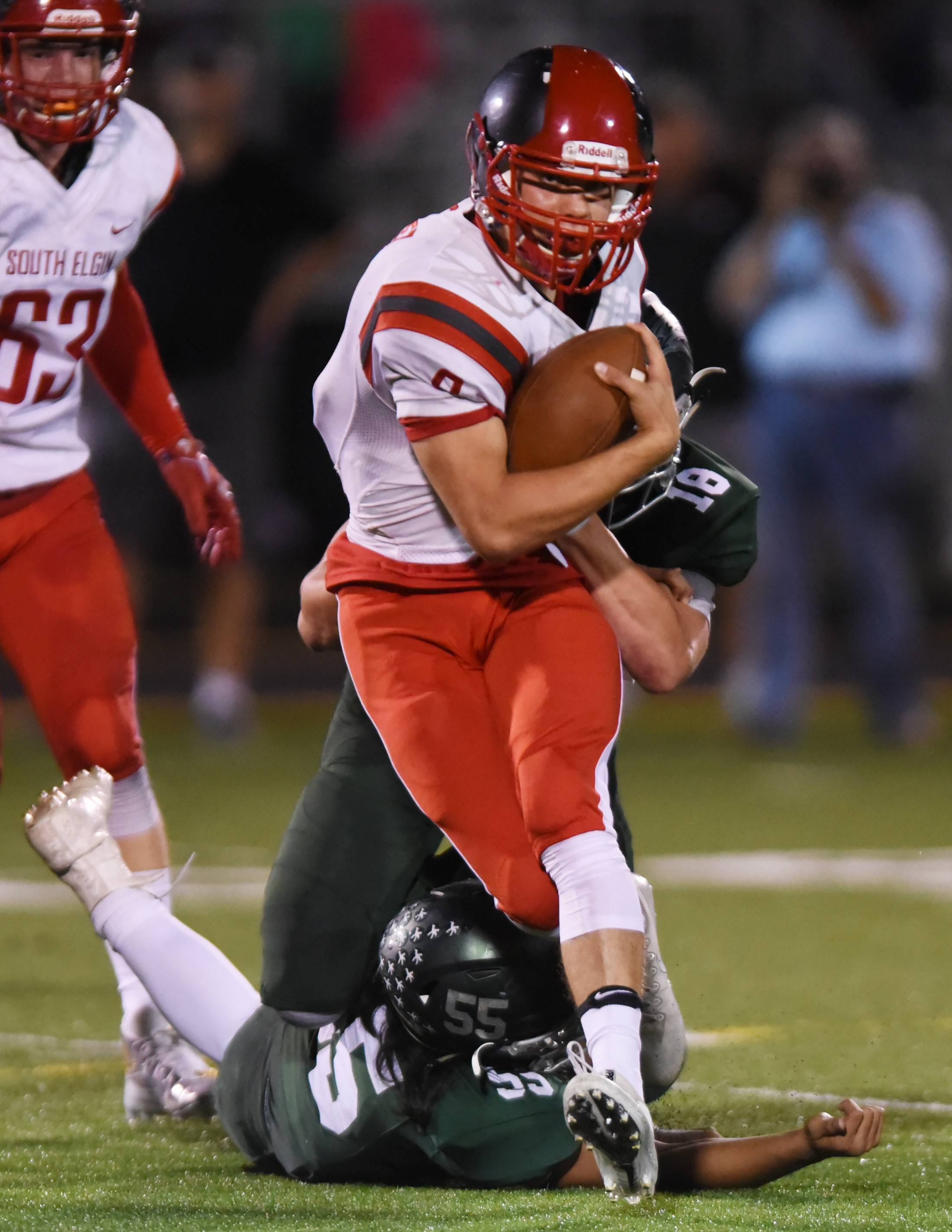 South Elgin quarterback Nate Gomez runs for yardage against Bartlett last Friday at Millennium Field in Streamwood. Gomez and the Storm host West Aurora Saturday in an Upstate Eight Valley battle of unbeaten teams.