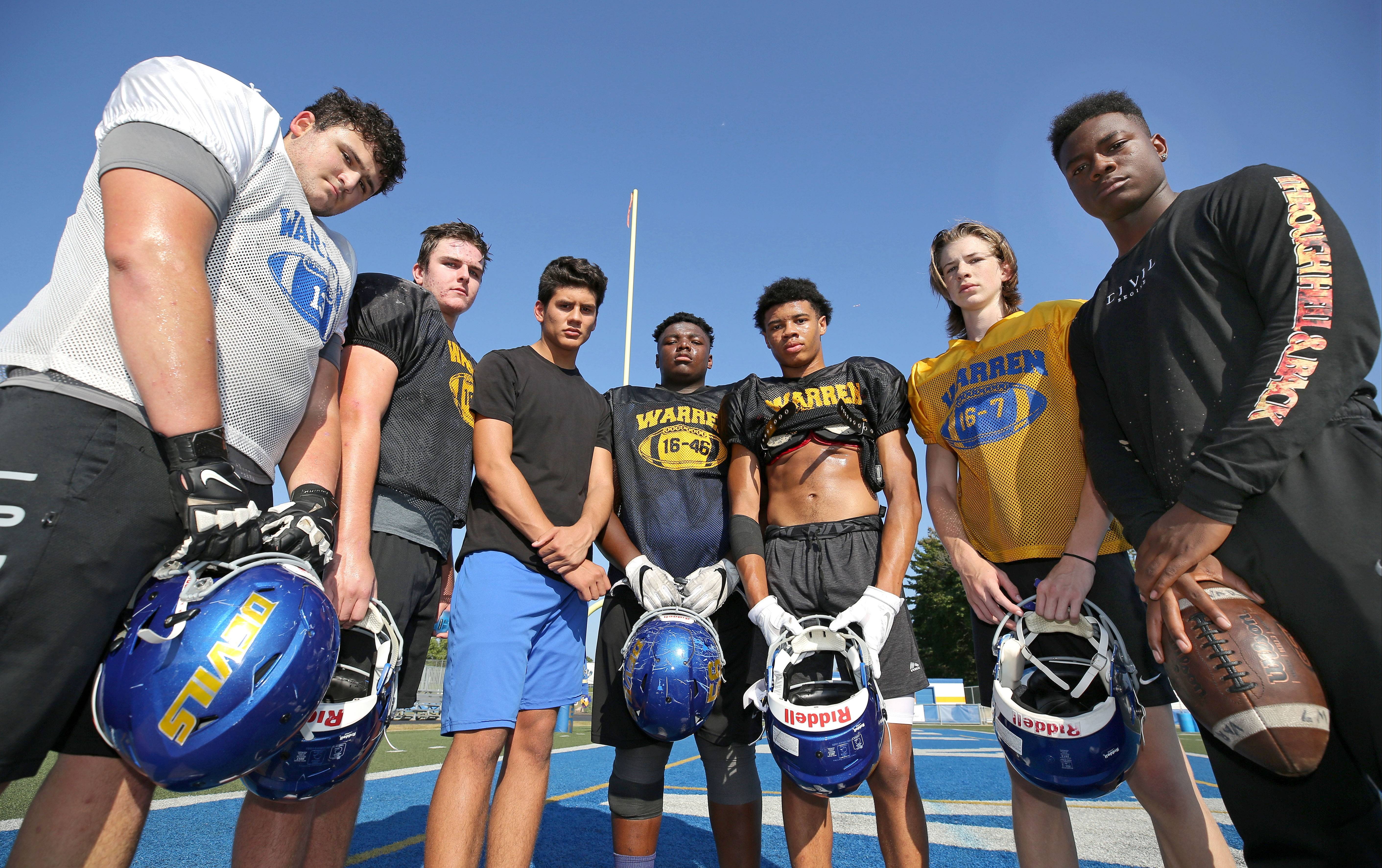 Warren's varsity football team is getting big contributions from an unusual source -- the sophomore class. From left, Matt Rich, Seamus Mellican, Juan Dela Cruz, Willis Singleton, Josh Turner, Adam Saul and Torris Childs.