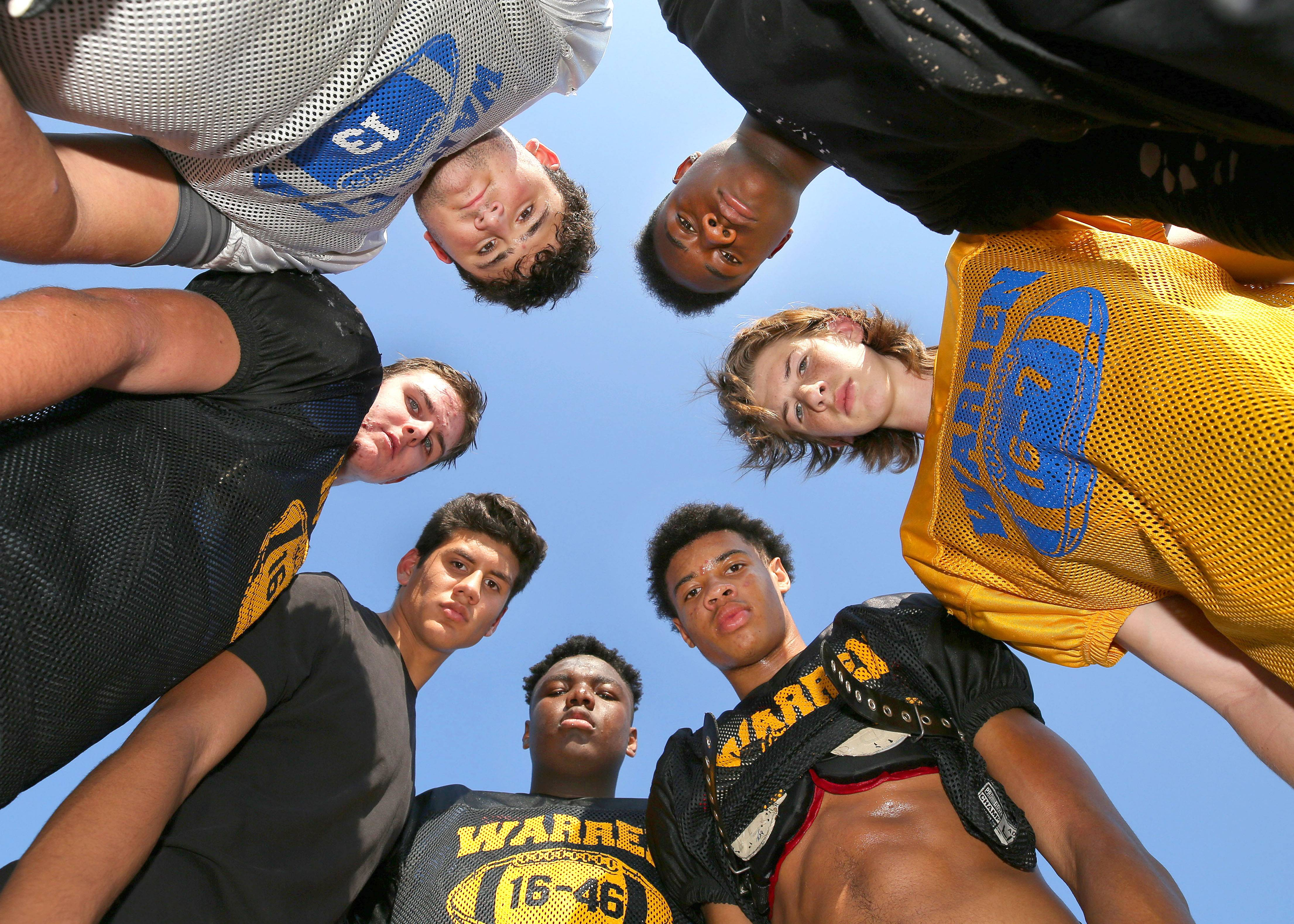Warren's varsity football team is getting big contributions from an unusual source -- the sophomore class. Counter-clockwise from left are Matt Rich, Seamus Mellican, Juan Dela Cruz, Willis Singleton, Josh Turner, Adam Saul and Torris Childs.