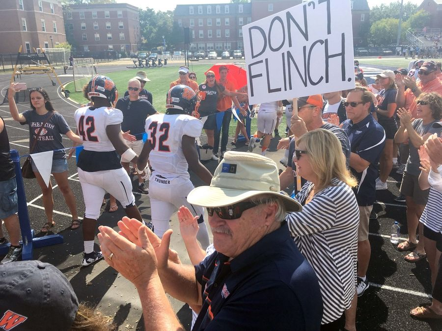 6ed810e7d At first Wheaton College game since hazing charges, fans support players