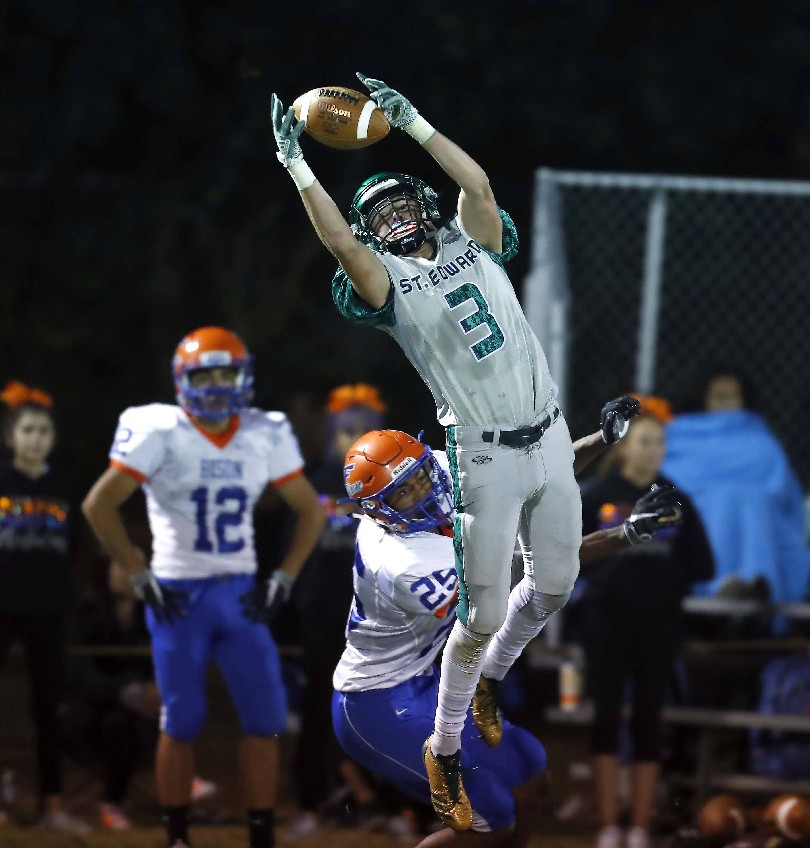 Brian Hill/bhill@dailyherald.comSt. Edward's Tyler Holte (3) hauls in a long pass for a touchdown Friday during Fenton at St. Edward football at Greg True Field in Elgin.
