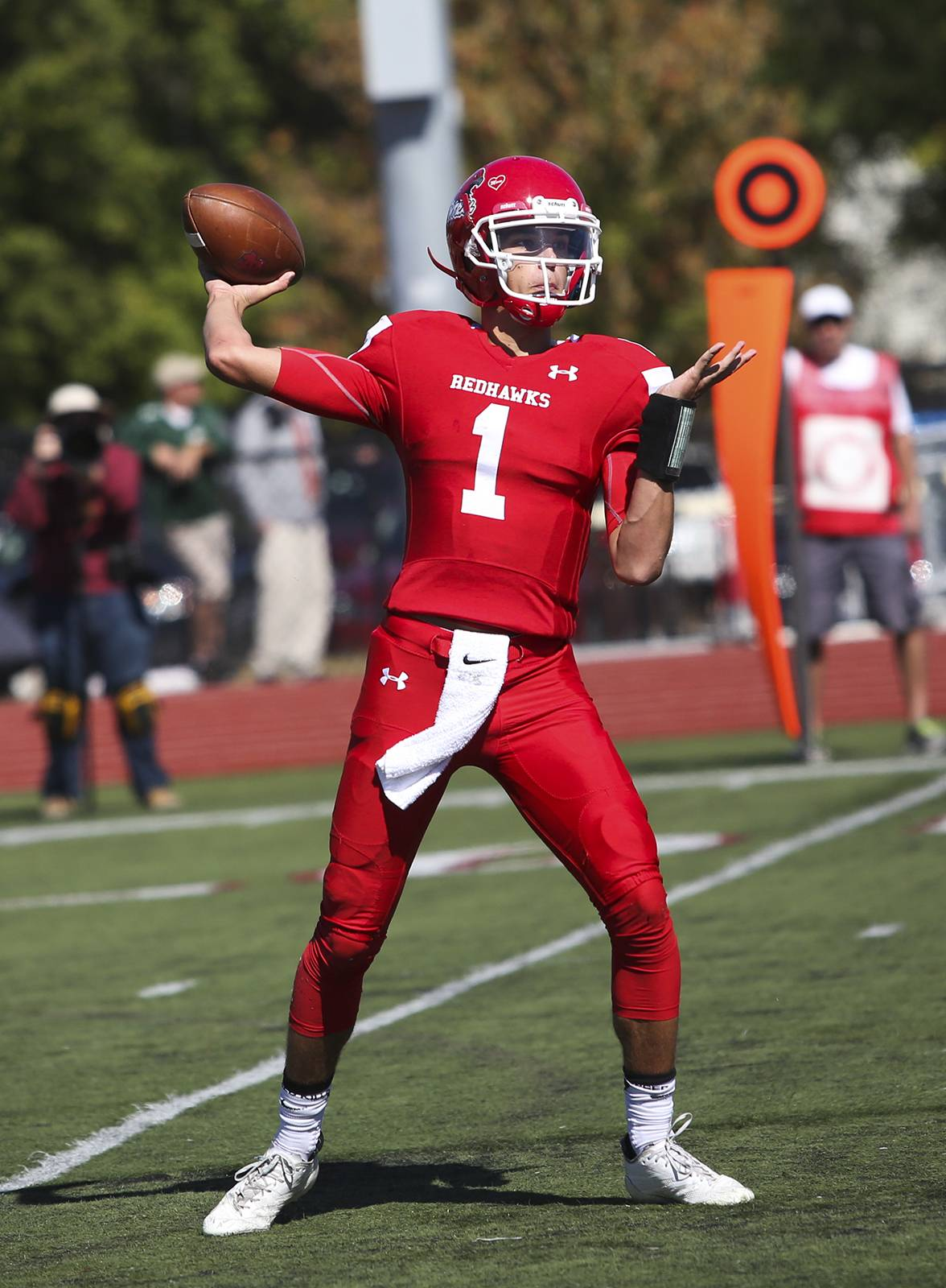 Naperville Central's Payton Thorne passes for a touchdown against St. Edward (Ohio) in Naperville, Ill. on Saturday, Sep. 30, 2017.
