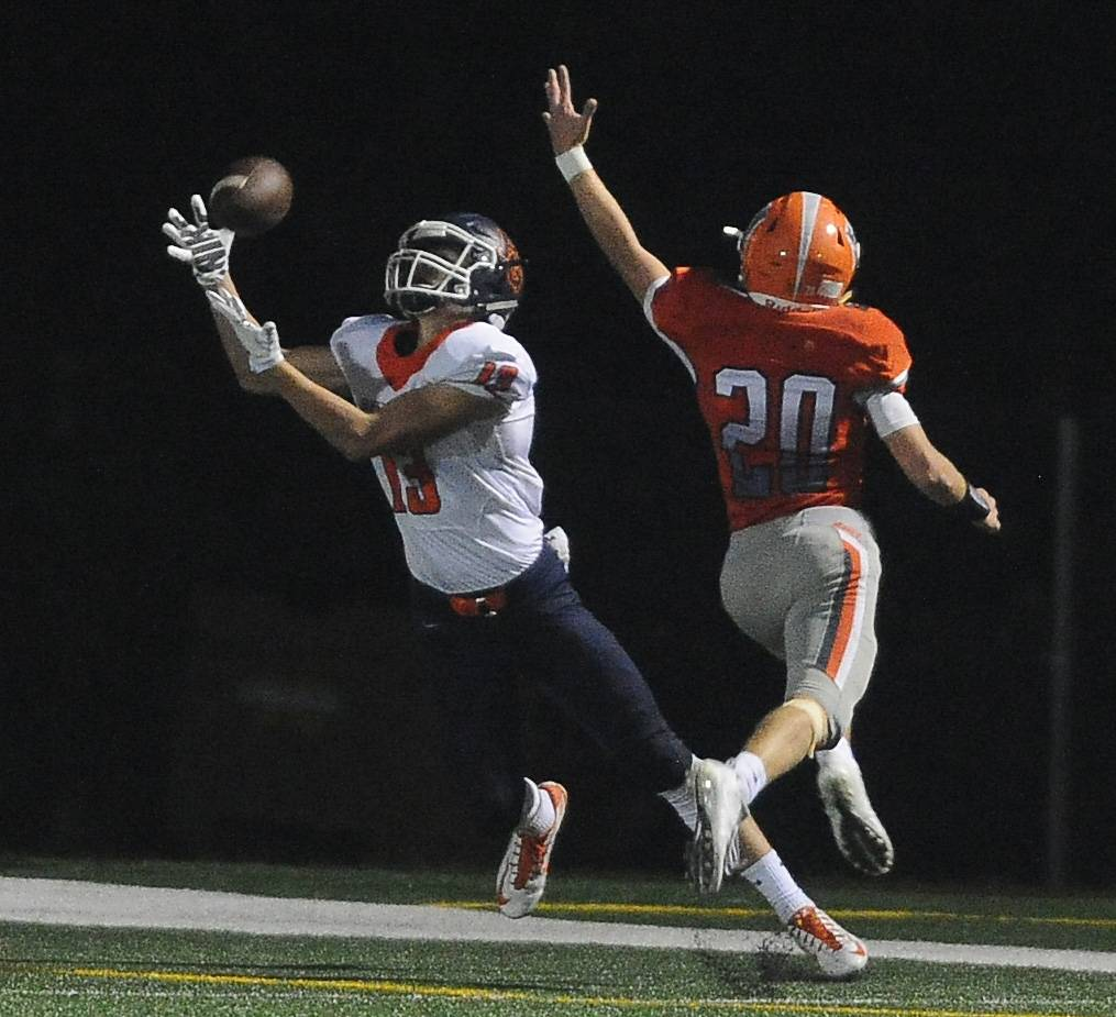 Buffalo Grove's Matt Prawica hauls in a late second-quarter touchdown as Hersey's Vince Carso defends at Hersey on Friday.