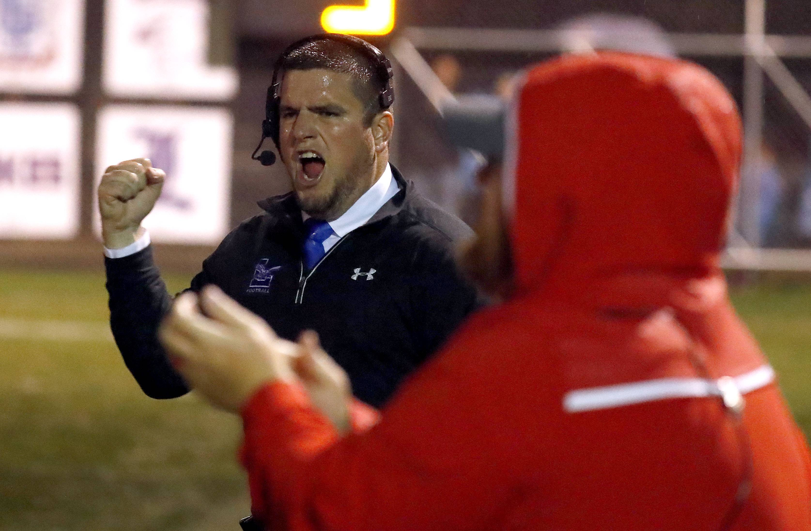 Lakes coach Jordan Eder cheers during the Eagles' matchup against Antioch on Friday night in Lake Villa.