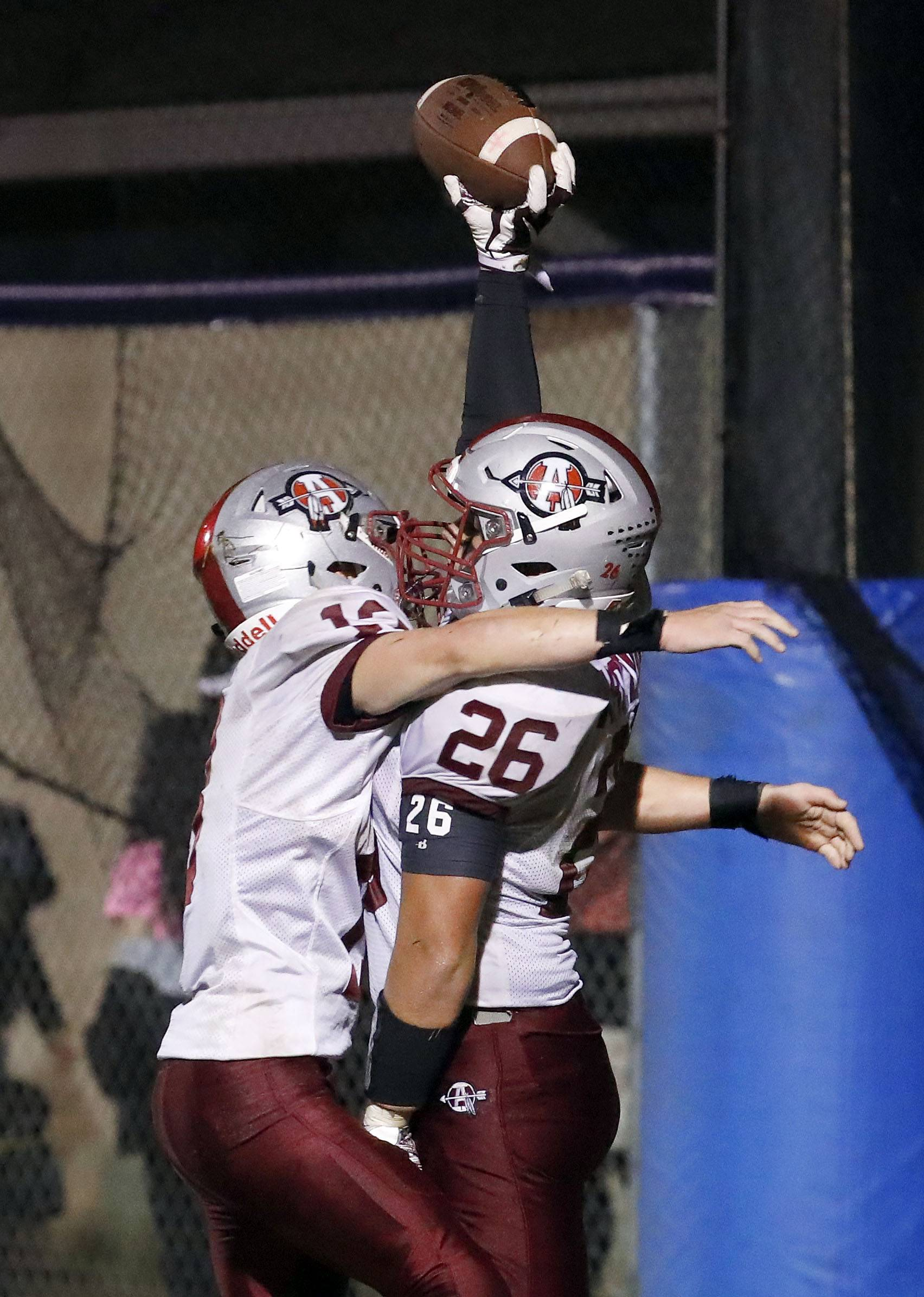 Antioch's Hunter Price celebrates with teammate Joseph Karolewicz (26) after a TD against Lakes Friday night in Lake Villa.