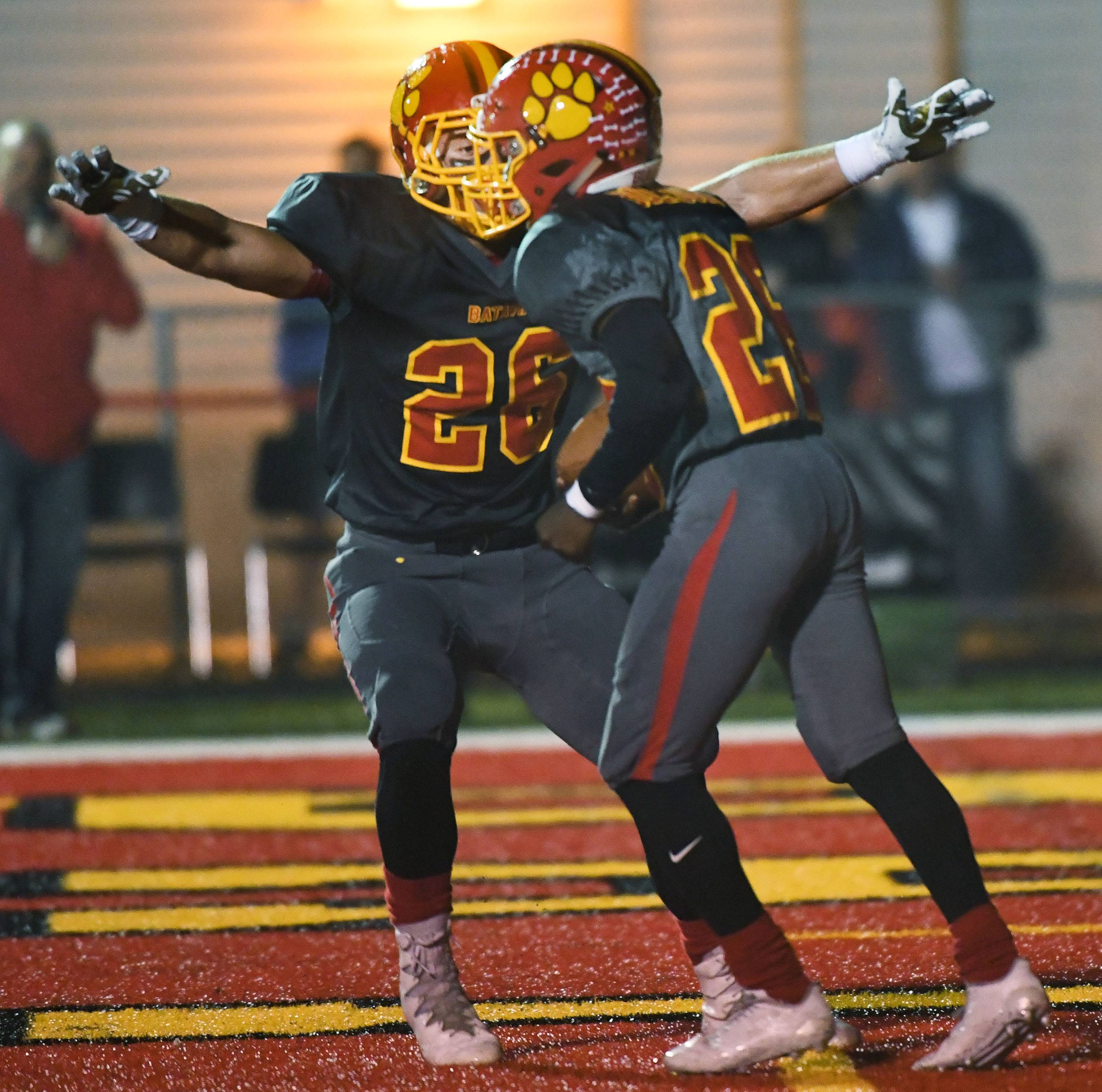 Batavia's Elijah Green celebrates a touchdown by Art Taylor -- the Bulldogs' only one of the game.