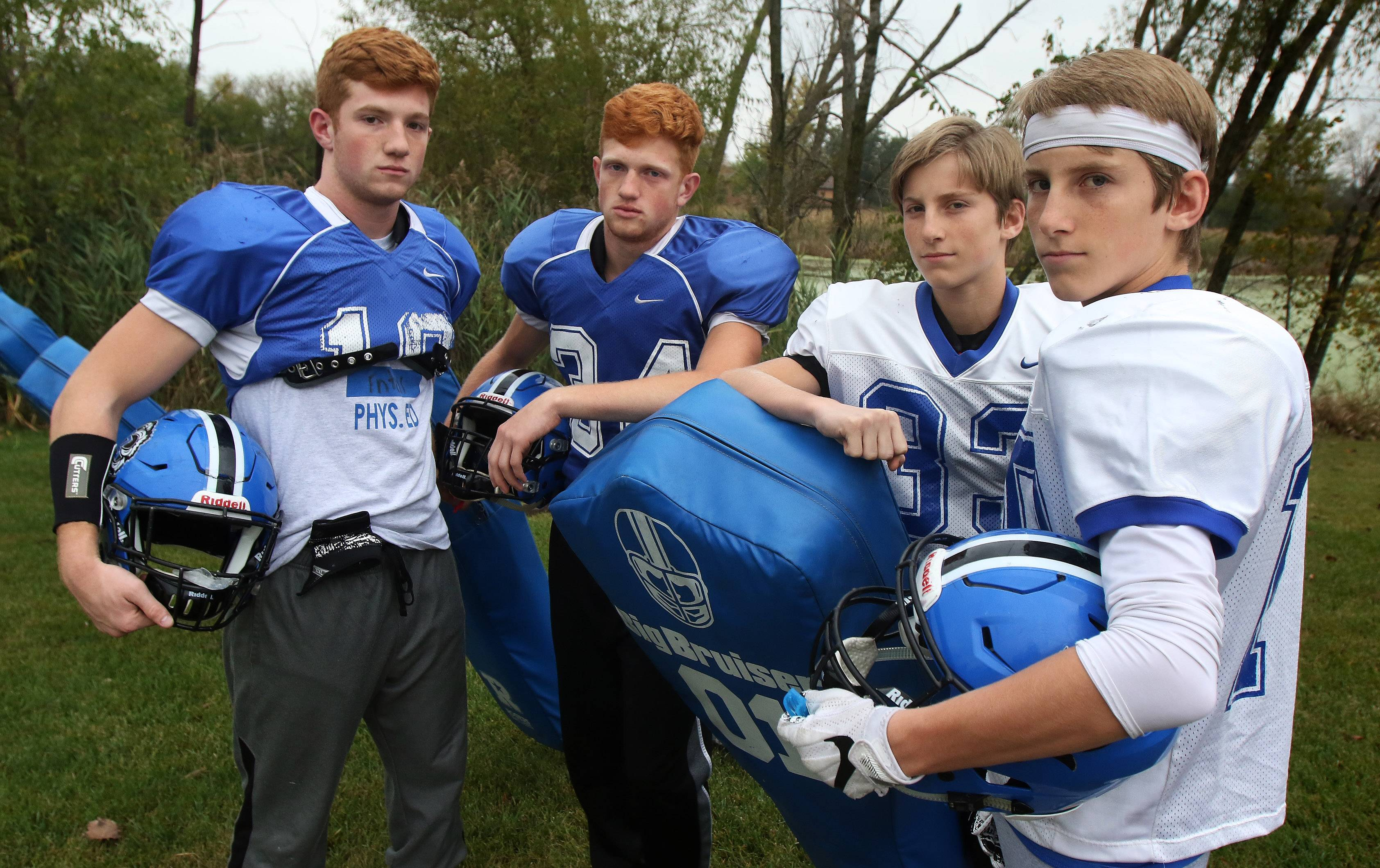 Brothers Matthijs and Marek Enters, left, and twins Jason and Justin Wollard typify the Lake Zurich football program's sense of family and brotherhood.
