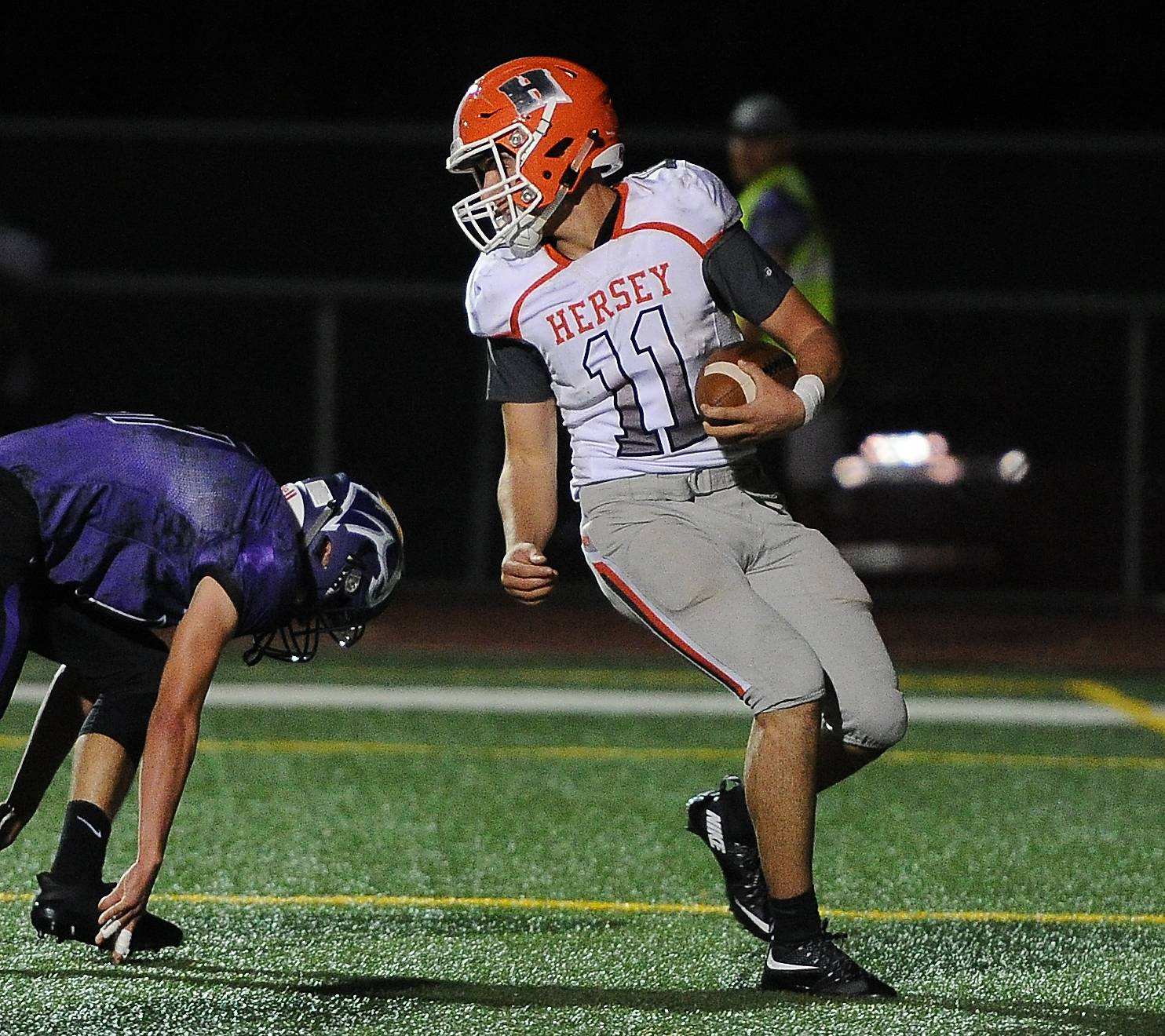 Hersey QB Owen Goldsberry keeps the ball and runs in for a first-quarter touchdown at Rolling Meadows on Friday.
