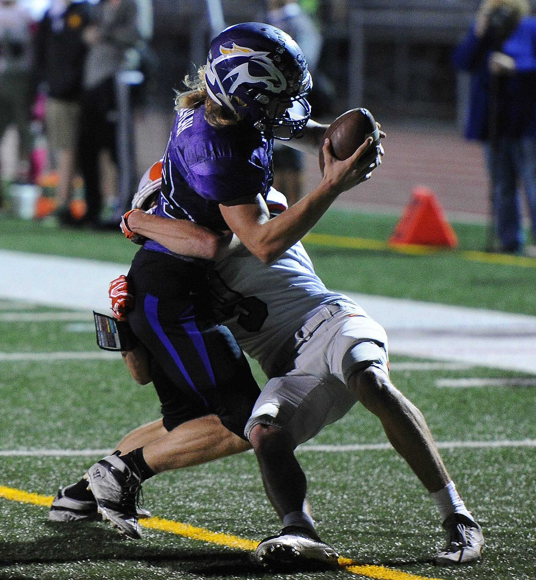 Rolling Meadows' Tim Szylak tries to score a touchdown but Hersey's Zakary Karman stops him short of the goal line in the first half at Rolling Meadows on Friday.
