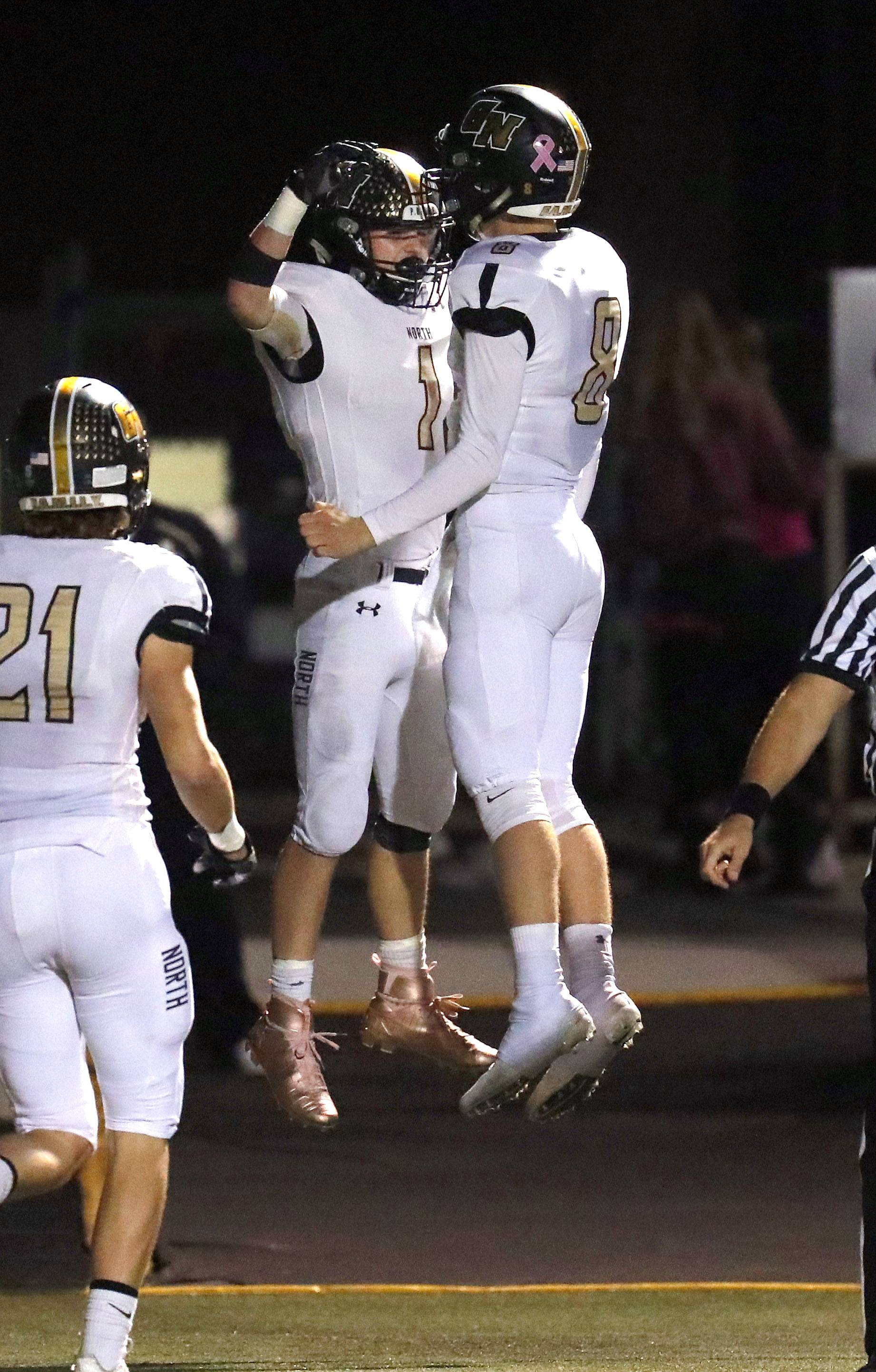 Grayslake North's Elliott Bubba Hochstein, left, and Austin Martineau celebrate after a first-half touchdown Friday night at Grayslake Central.