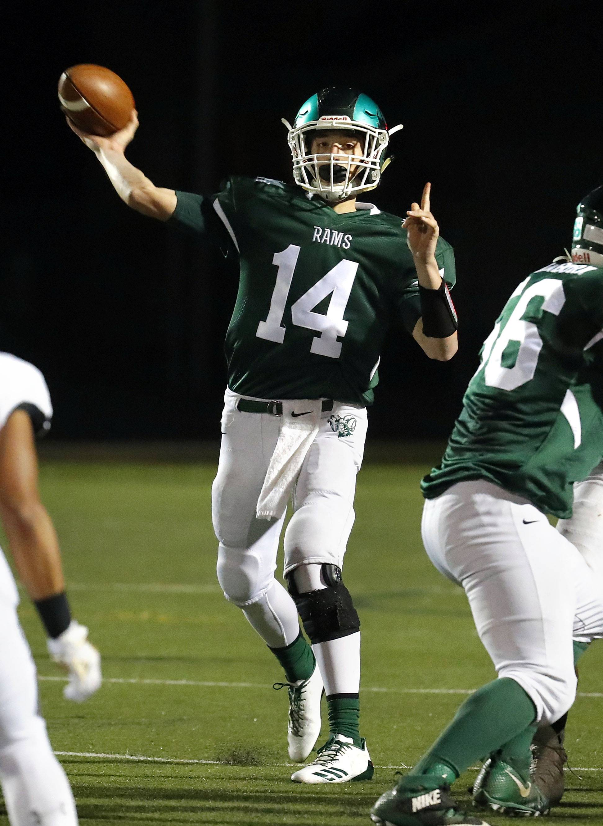 Grayslake Central QB Sam Lennartz passes against Grayslake North on Friday night at Grayslake Central.
