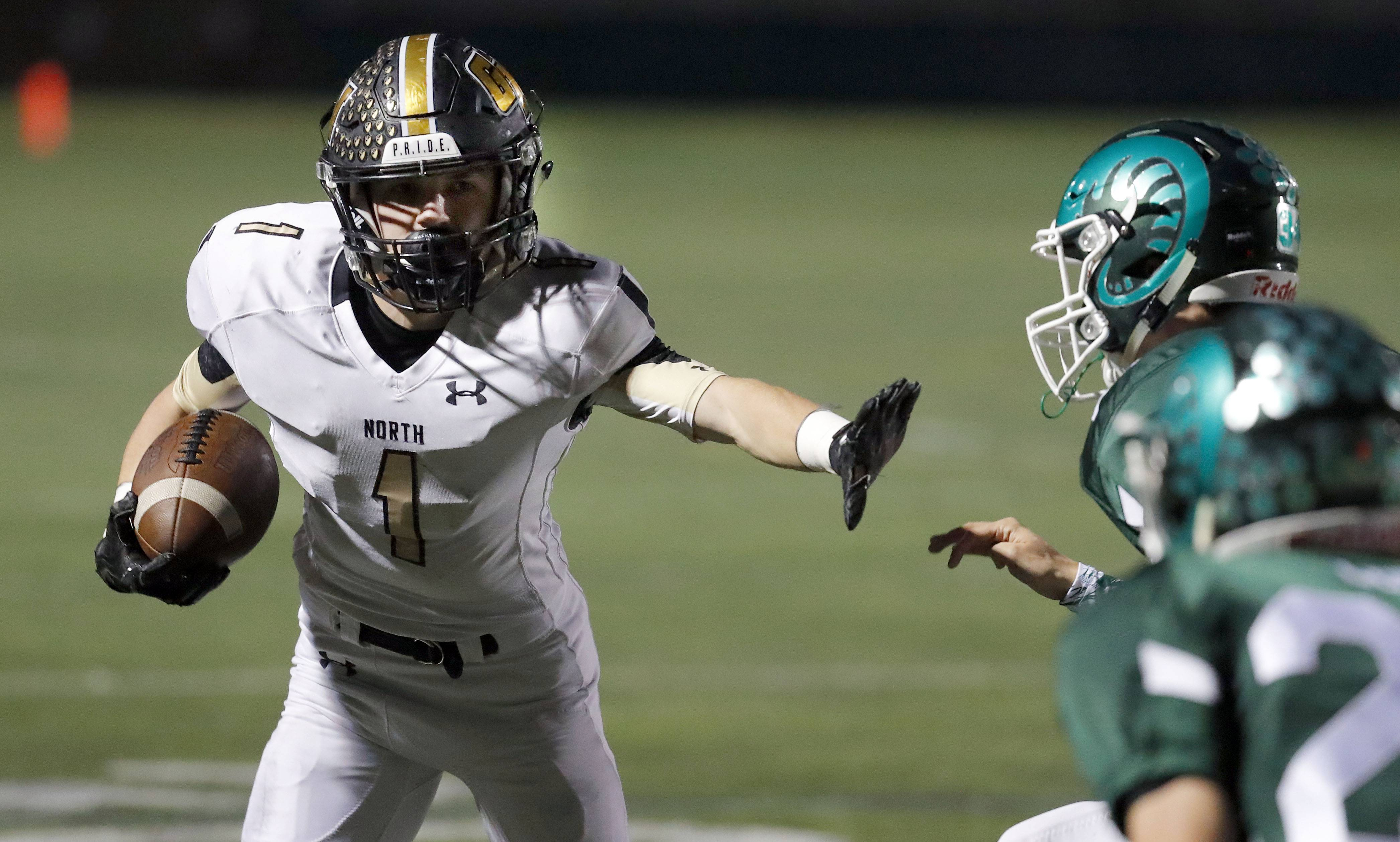 Grayslake North's Elliott Bubba Hochstein, left, tries to turn the corner Friday night at Grayslake Central.
