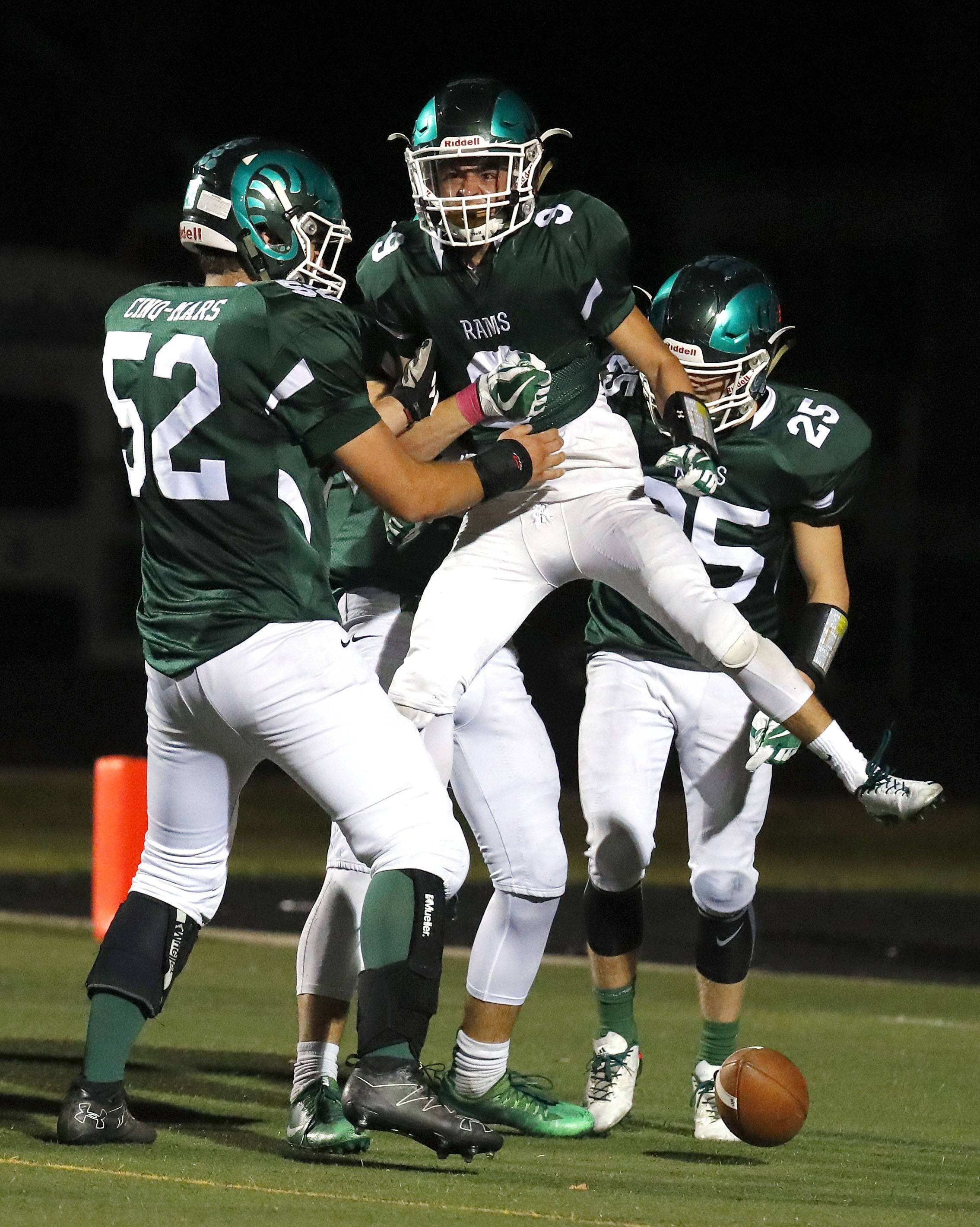 Grayslake Central's Jordan Franco celebrates with teammates after a touchdown catch against Grayslake North on Friday night at Grayslake Central.