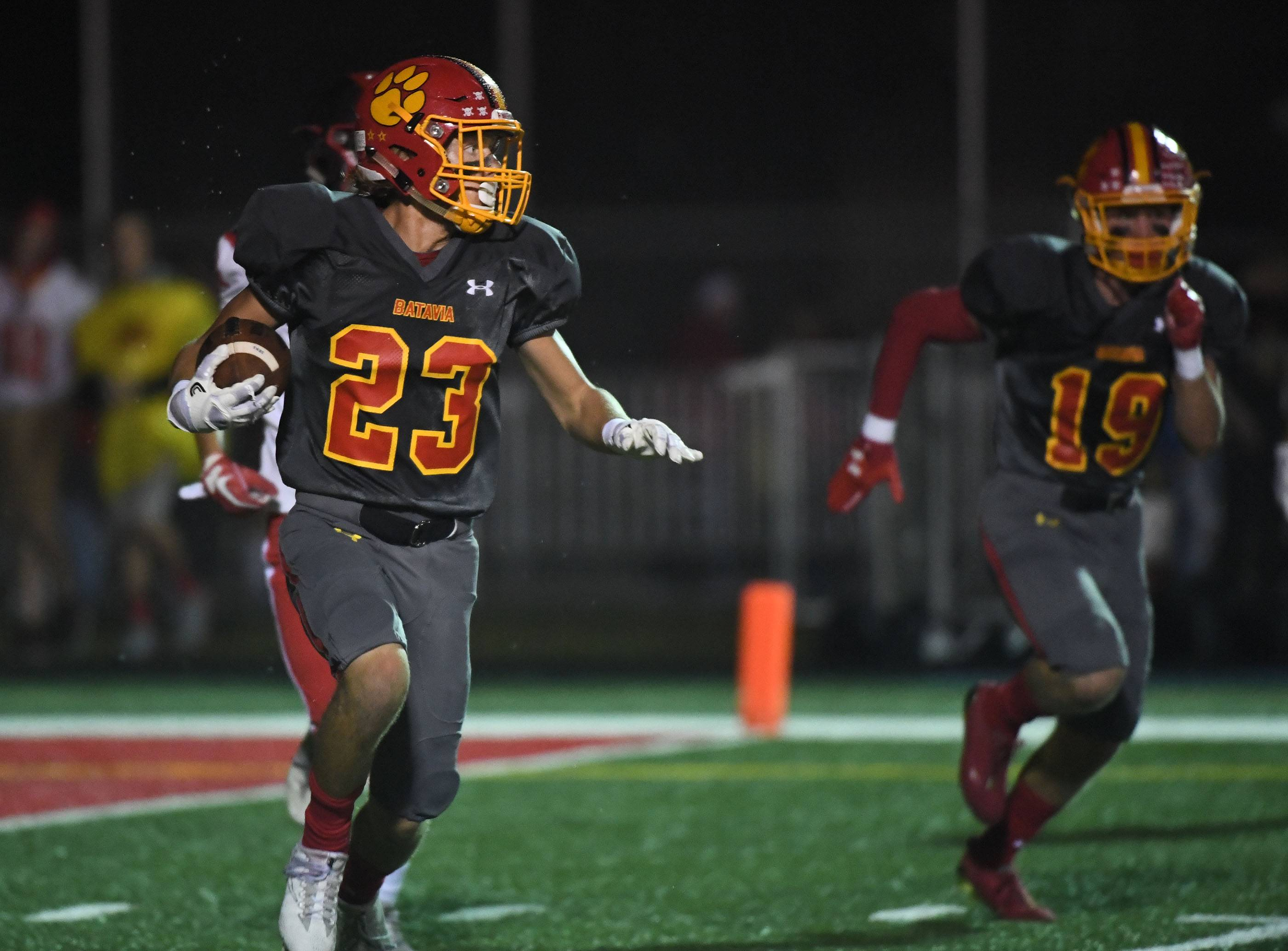 Batavia's Tom Stuttle (23) returns an interception in the end zone late in the first half against South Elgin earlier this season. Stuttle, who leads the Fox Valley area with 6 interceptions this season, will lead the 8-0 Bulldogs into action Friday against 7-1 St. Charles North.