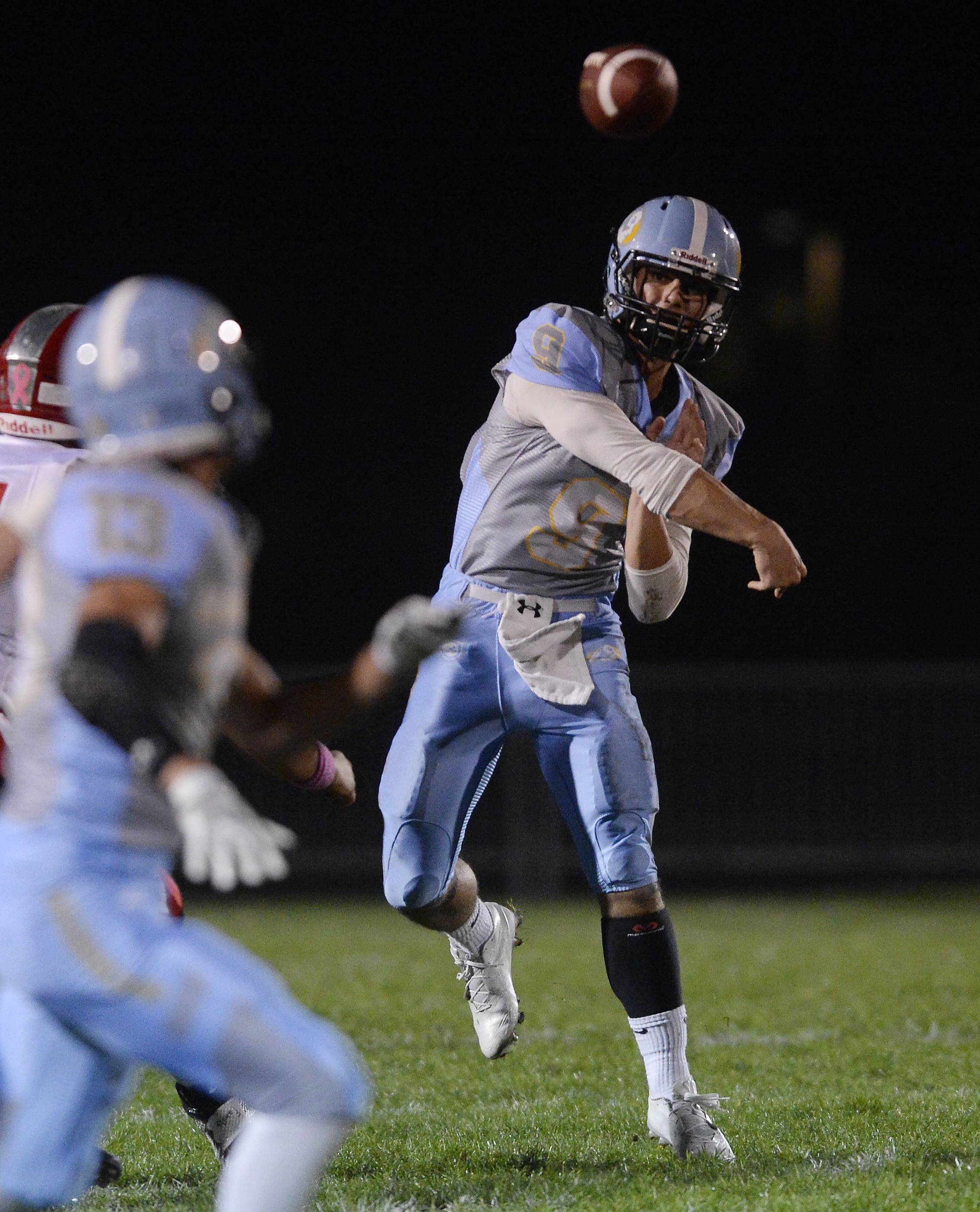 Maine West quarterback George Markakis passes to Rafael Ynocencio but has the play broken up by Deerfield's defense in the first quarter Friday.