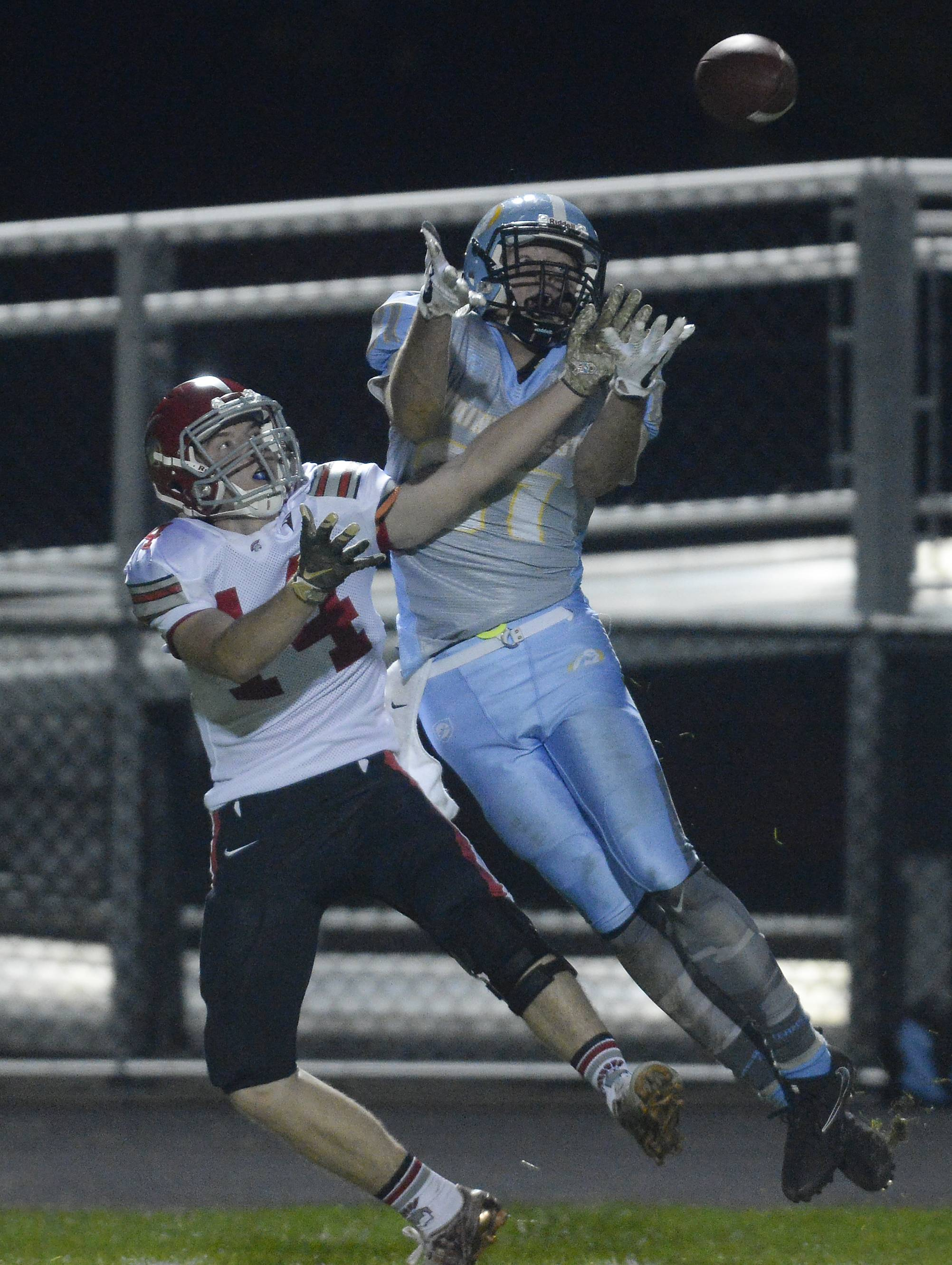 Maine West's Matt Kentgen battles Deerfield's Tyler Crann on a pass that was incomplete in the second quarter at Maine West on Friday.